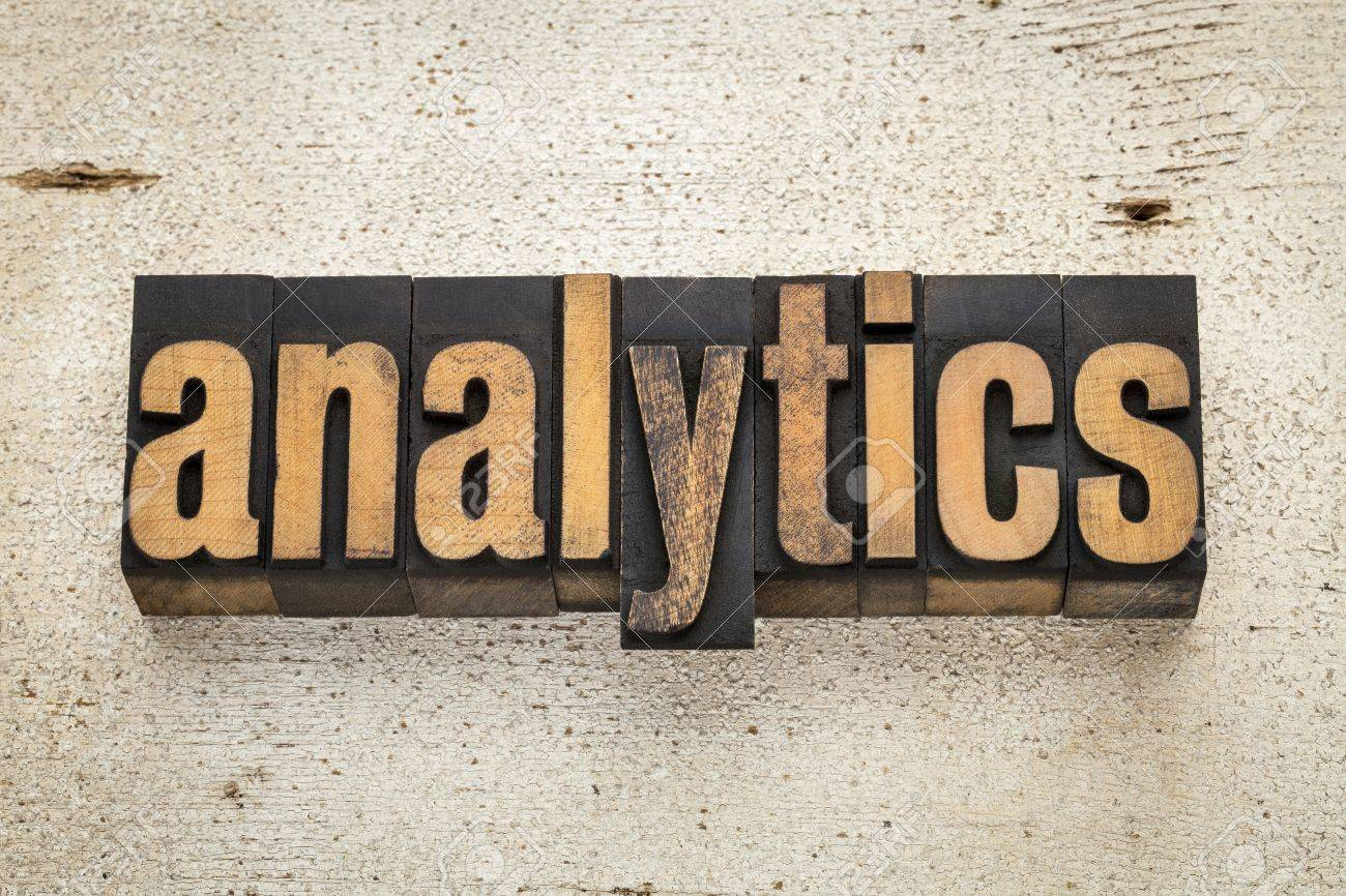 analytics word in vintage letterpress wood type on a grunge painted barn wood background Stock Photo - 20590329
