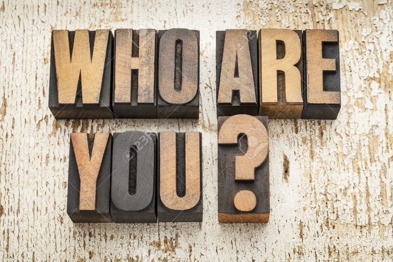 who are you question in vintage letterpress wood type on a grunge painted barn wood background Stock Photo - 20832362