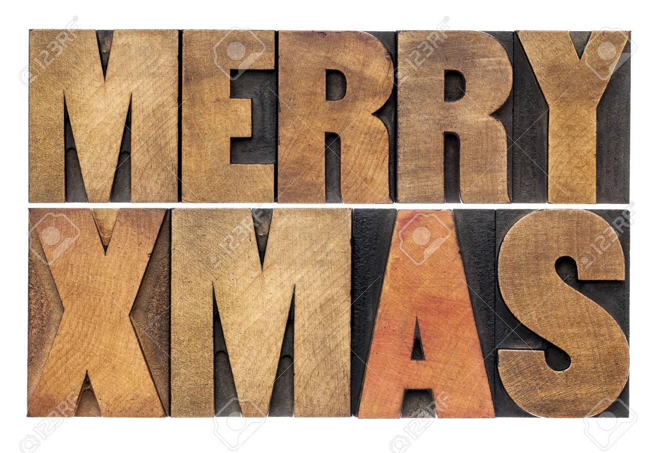 Merry Xmas (Christmas) greetings or wishes - isolated text in vintage letterpress wood type blocks Stock Photo - 22443326
