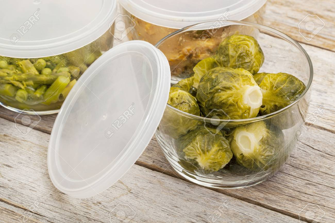dinner meal or leftovers (chicken, brussels sprouts, asparagus, green pea) stored in glass containers Stock Photo - 24172103