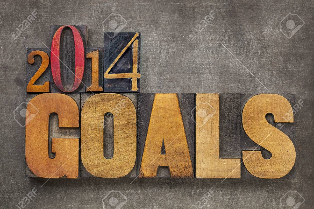 2014 goals - New Year resolution concept - text in vintage letterpress wood type blocks against grunge metal Stock Photo - 24172117