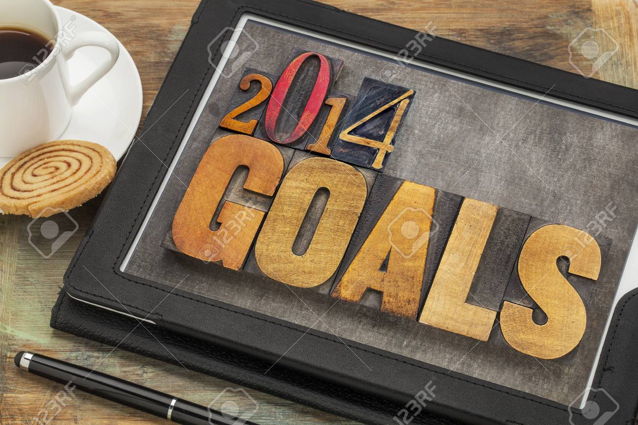 2014 goals - New Year resolution concept - text in vintage letterpress wood type on a digital tablet screen Stock Photo - 24231192