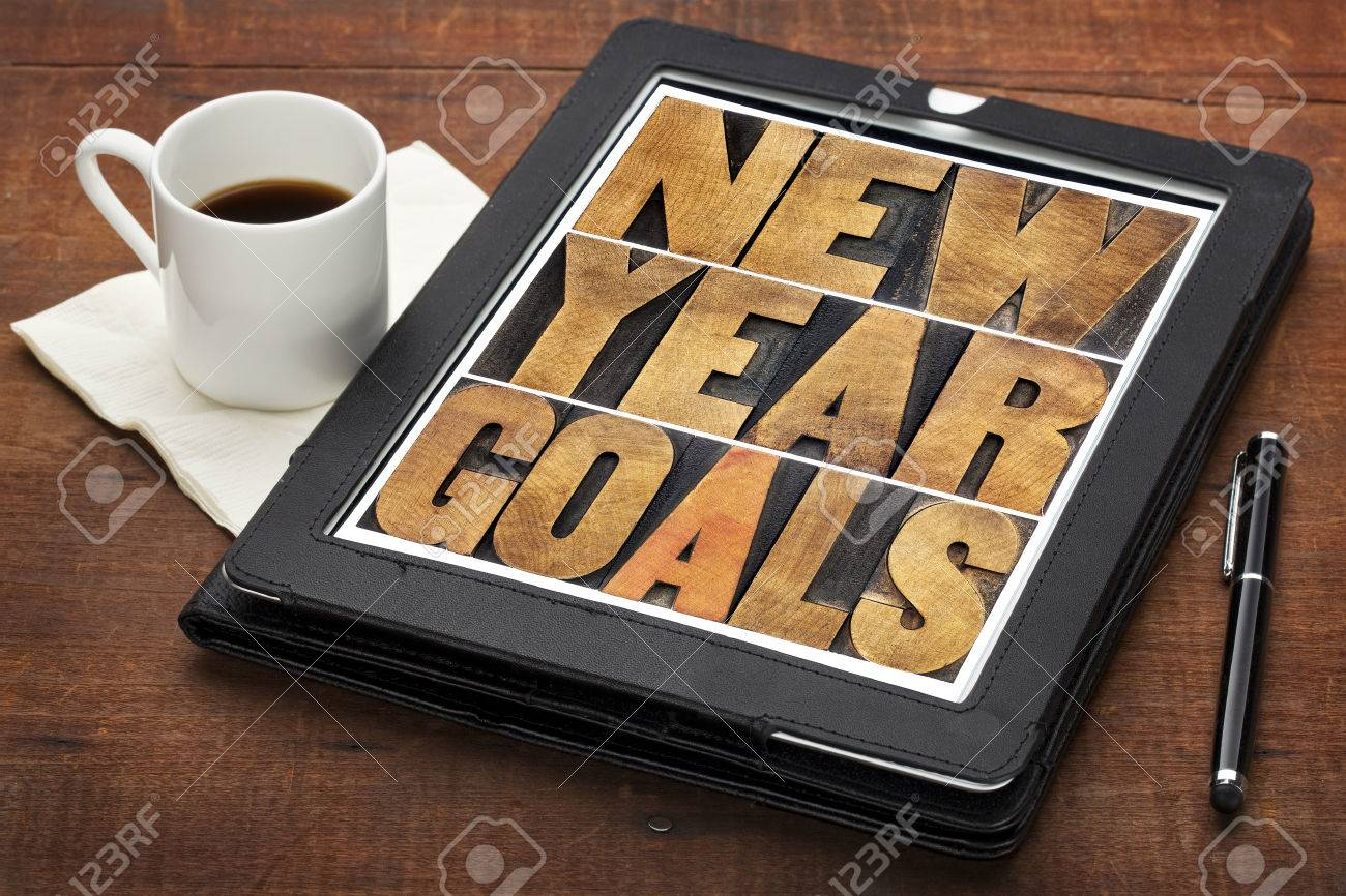 New Year goals - resolutions concept - text in vintage letterpress wood type on a digital tablet screen Stock Photo - 24258294