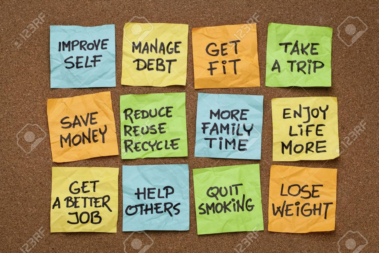 popular new year resolutions colorful sticky notes on a cork stock photo popular new year resolutions colorful sticky notes on a cork board