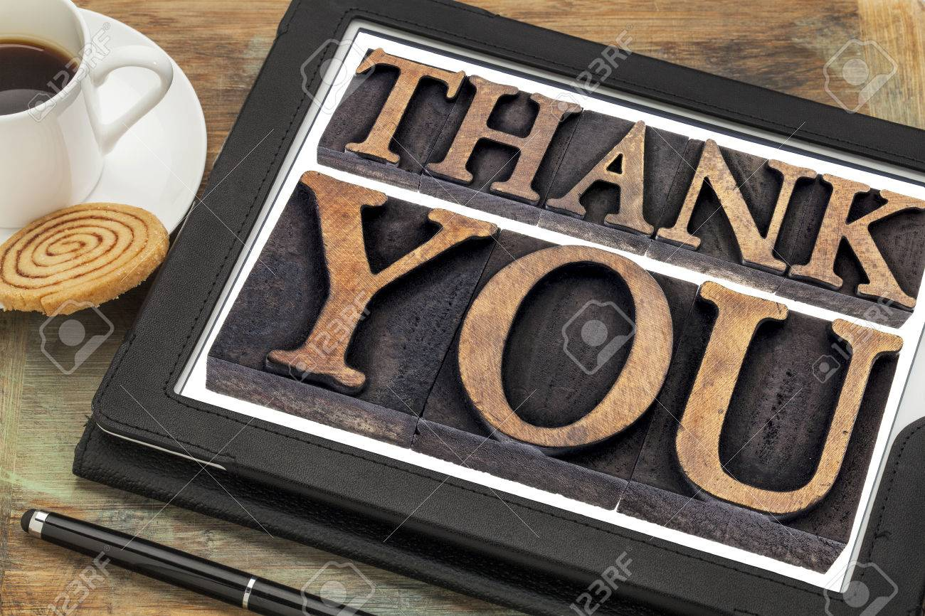 thank you  - text in vintage letterpress wood type on a digital tablet with coffee Stock Photo - 24733505