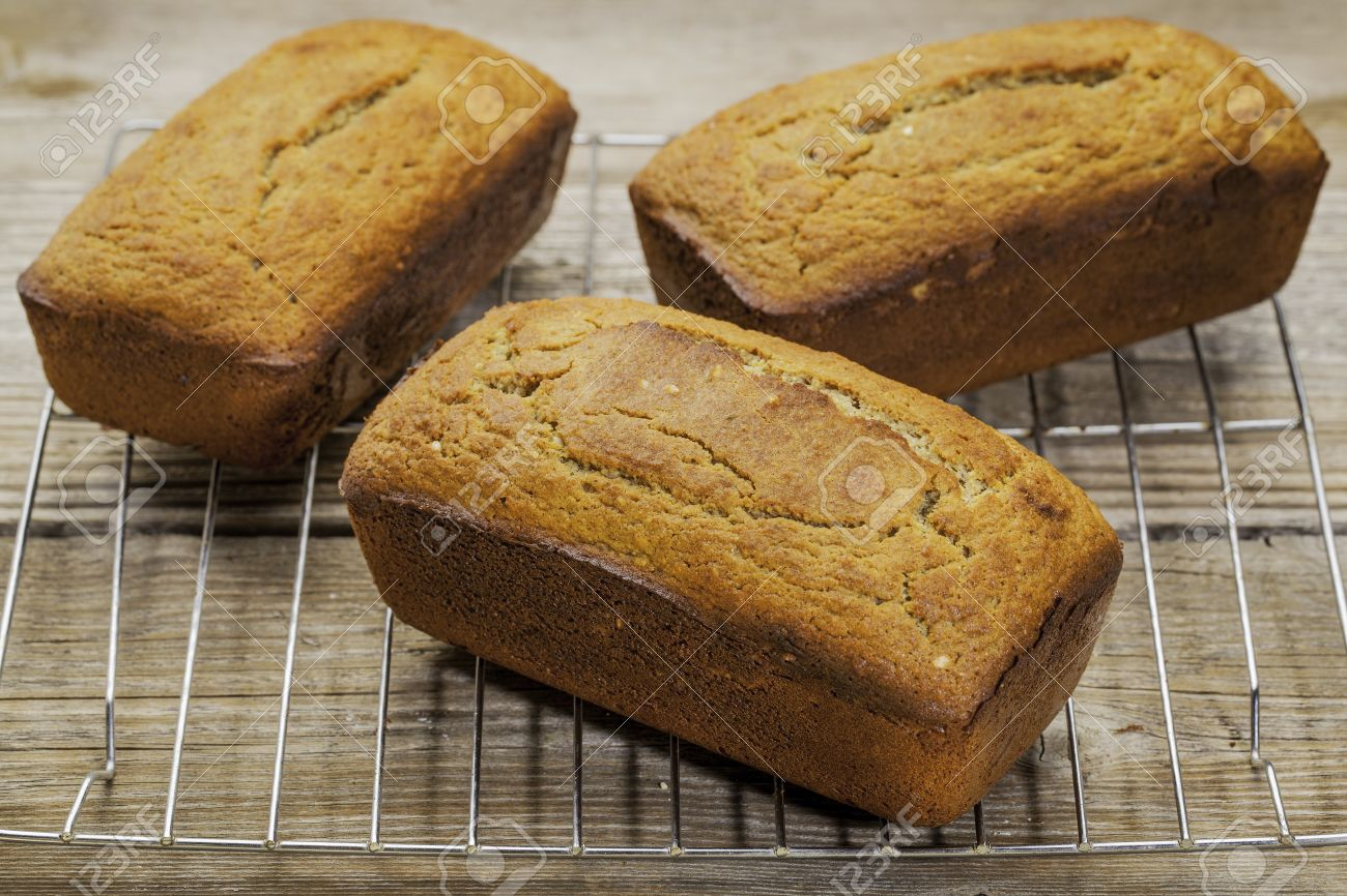 three loafs of freshly baked gluten free bread prepared with coconut and almond flour, flaxseed meal with sesame seeds Stock Photo - 24876212