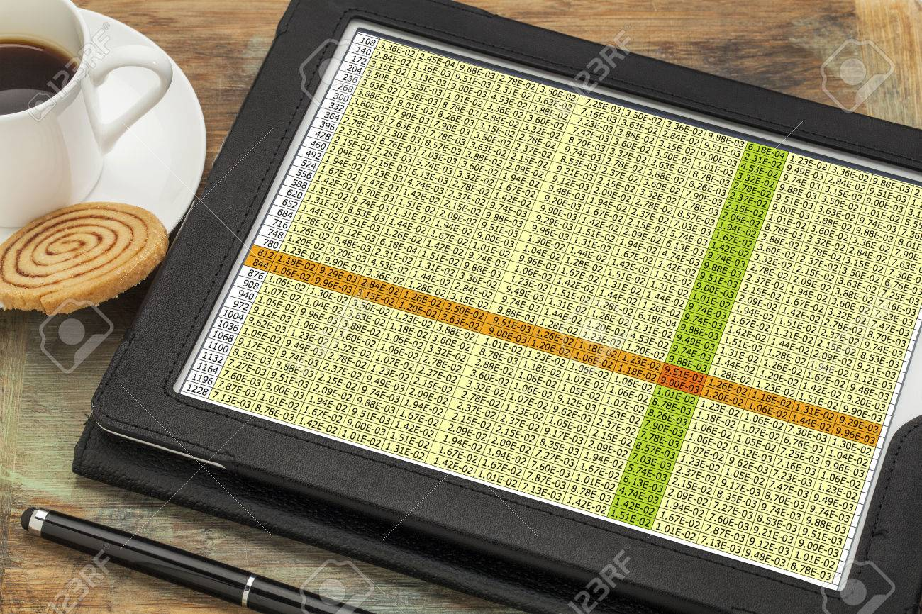 data spreadsheet on a digital tablet with a cup of coffee - 25759237