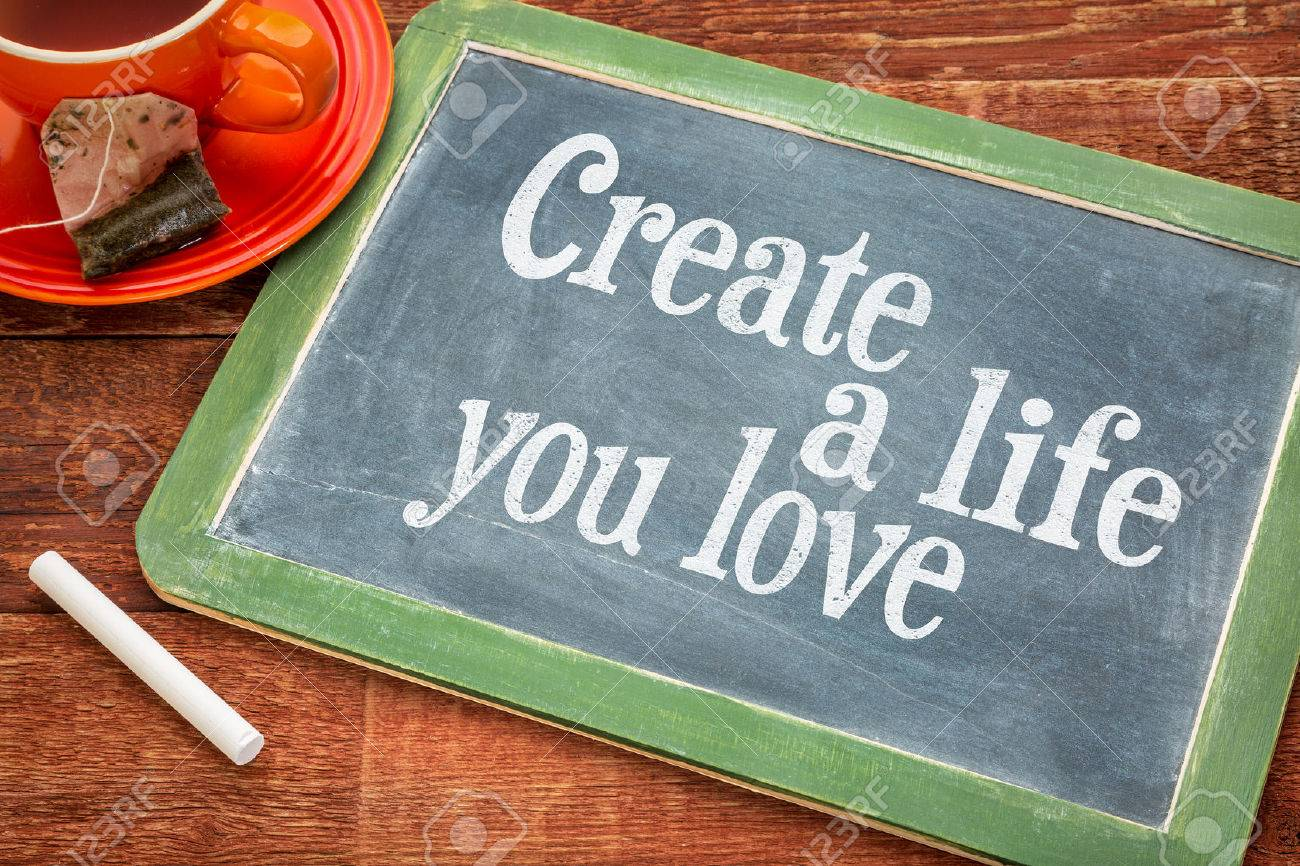 Create life you love motivational advice - text  on a slate blackboard with chalk and cup of tea Stock Photo - 41919605