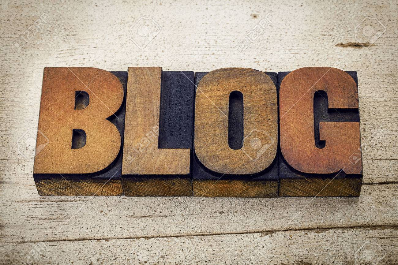 blog - a word in vintage letterpress wood type on a grunge white painted barn wood background Stock Photo - 44174431