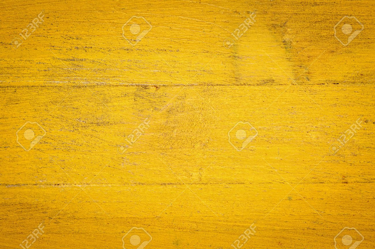 closeup of grunge yellow painted, rough wood background Stock Photo - 44590105
