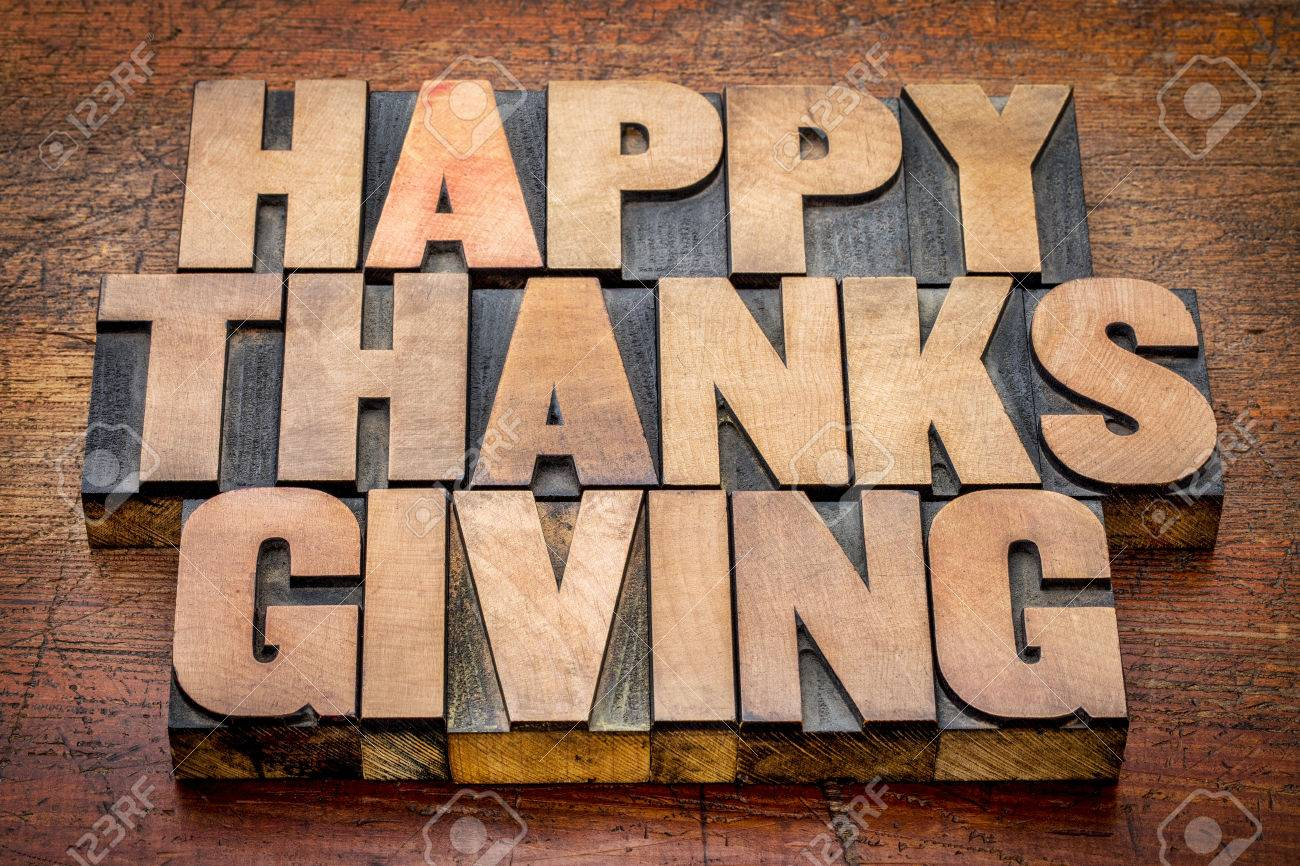 Happy Thanksgiving greetings card or sign -  text in vintage letterpress wood type blocks against rustic wood Stock Photo - 44976982