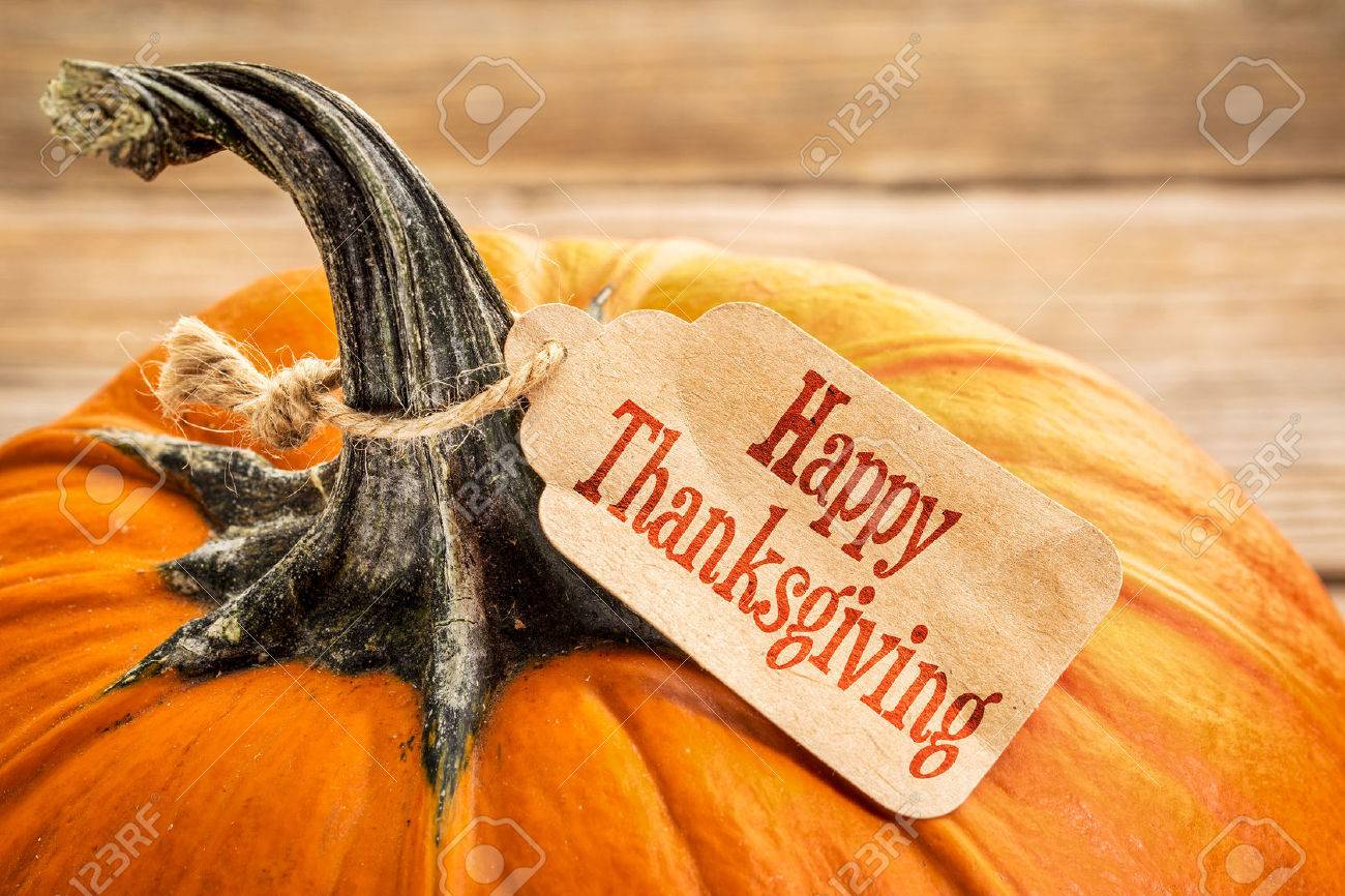pumpkin with a Happy Thanksgiving paper price tag -  holiday shopping concept Stock Photo - 47343777