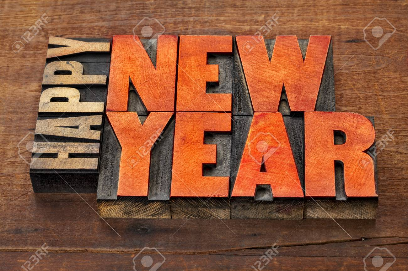 happy new year greeting card word abstract in vintage letterpress wood type blocks stained by