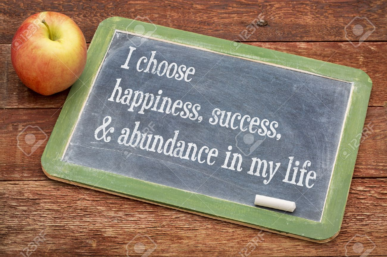 I choose happiness, success and abundance in my life - positive affirmation words on a slate blackboard against red barn wood Stock Photo - 50275629