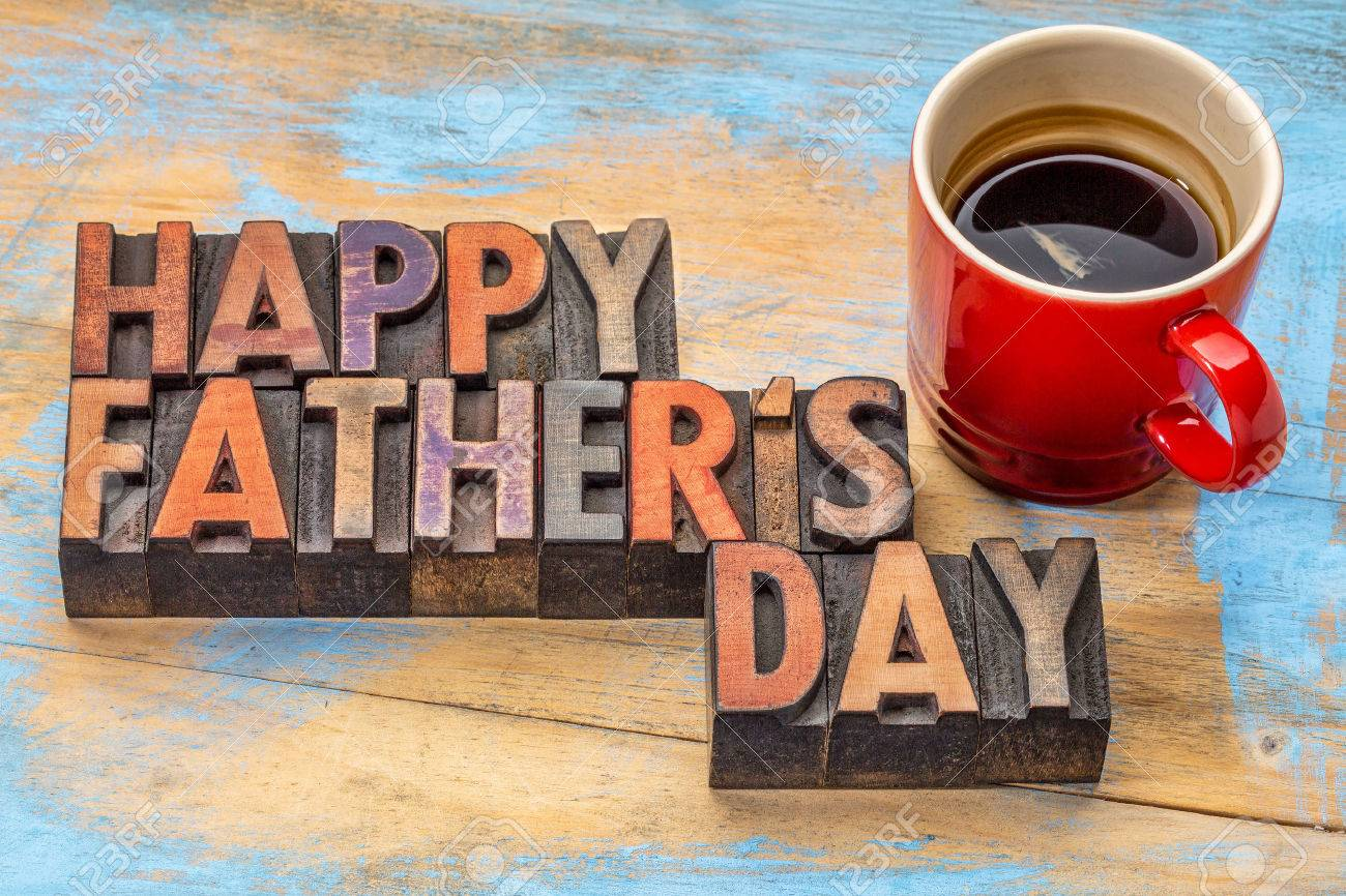 happy father's day in vintage wood letterpress printing blocks with a cup of coffee Stock Photo - 50876707