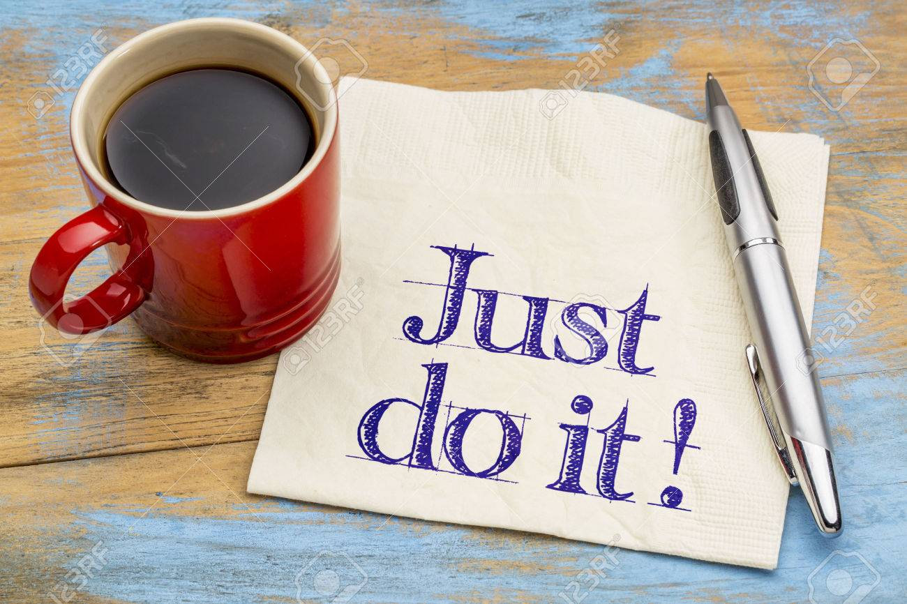 Just do it motivational advice on napkin with a cup of coffee. Motivation concept. - 52656214