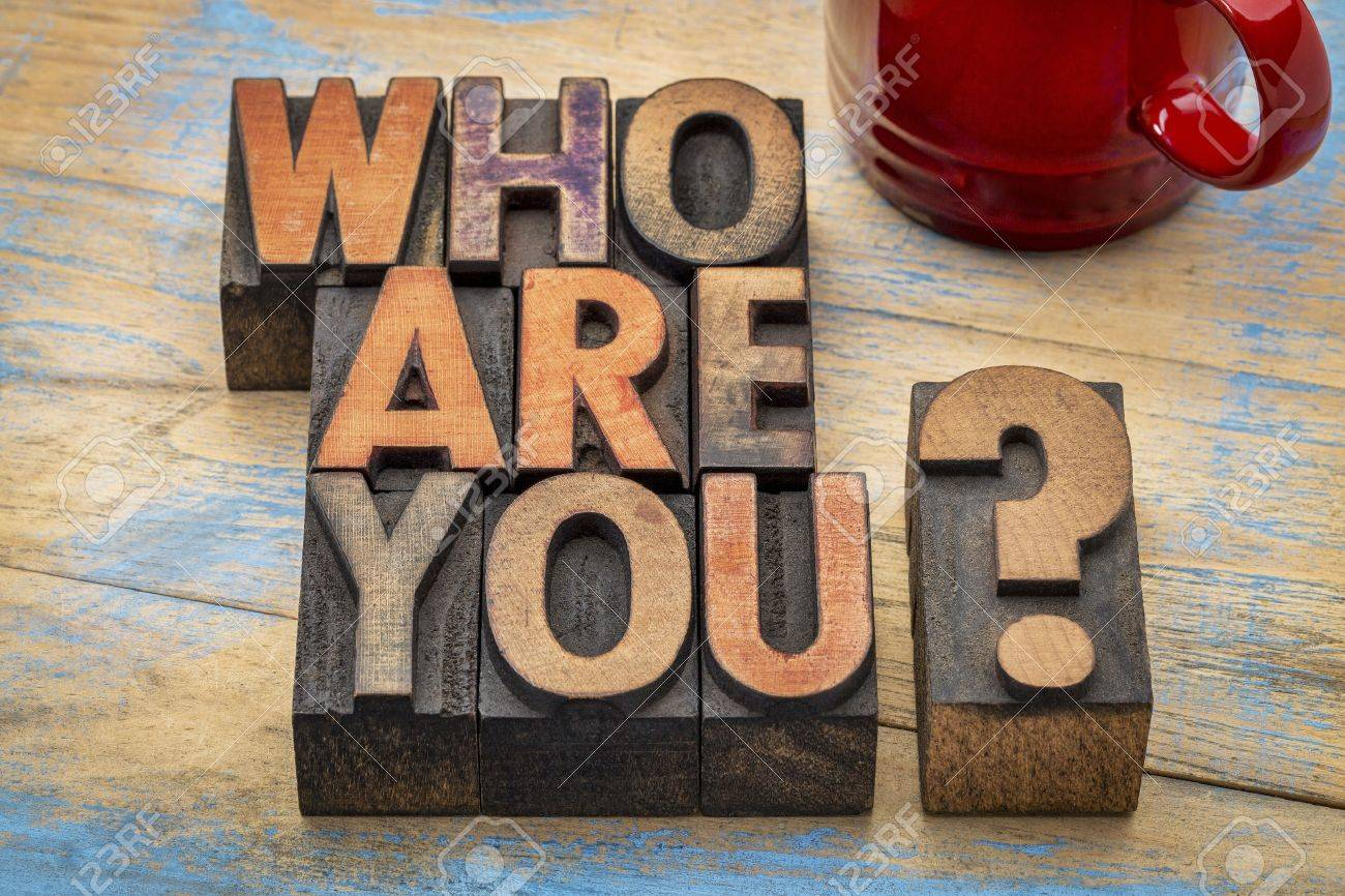 Who are you question in vintage letterpress wood type printing blocks with a cup of coffee - 52656977