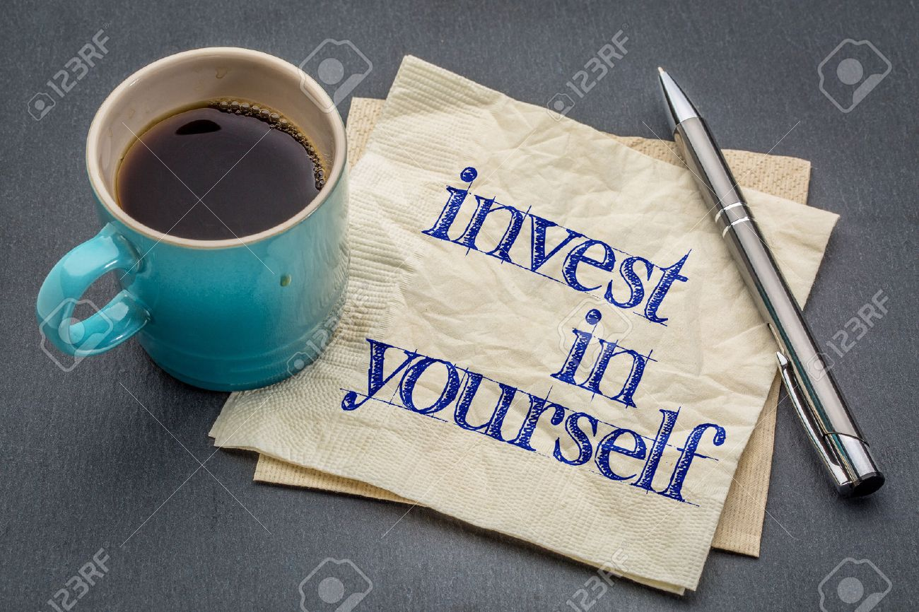 Invest in yourself advice or reminder - handwriting on a napkin with cup of coffee against gray slate stone background - 55759351