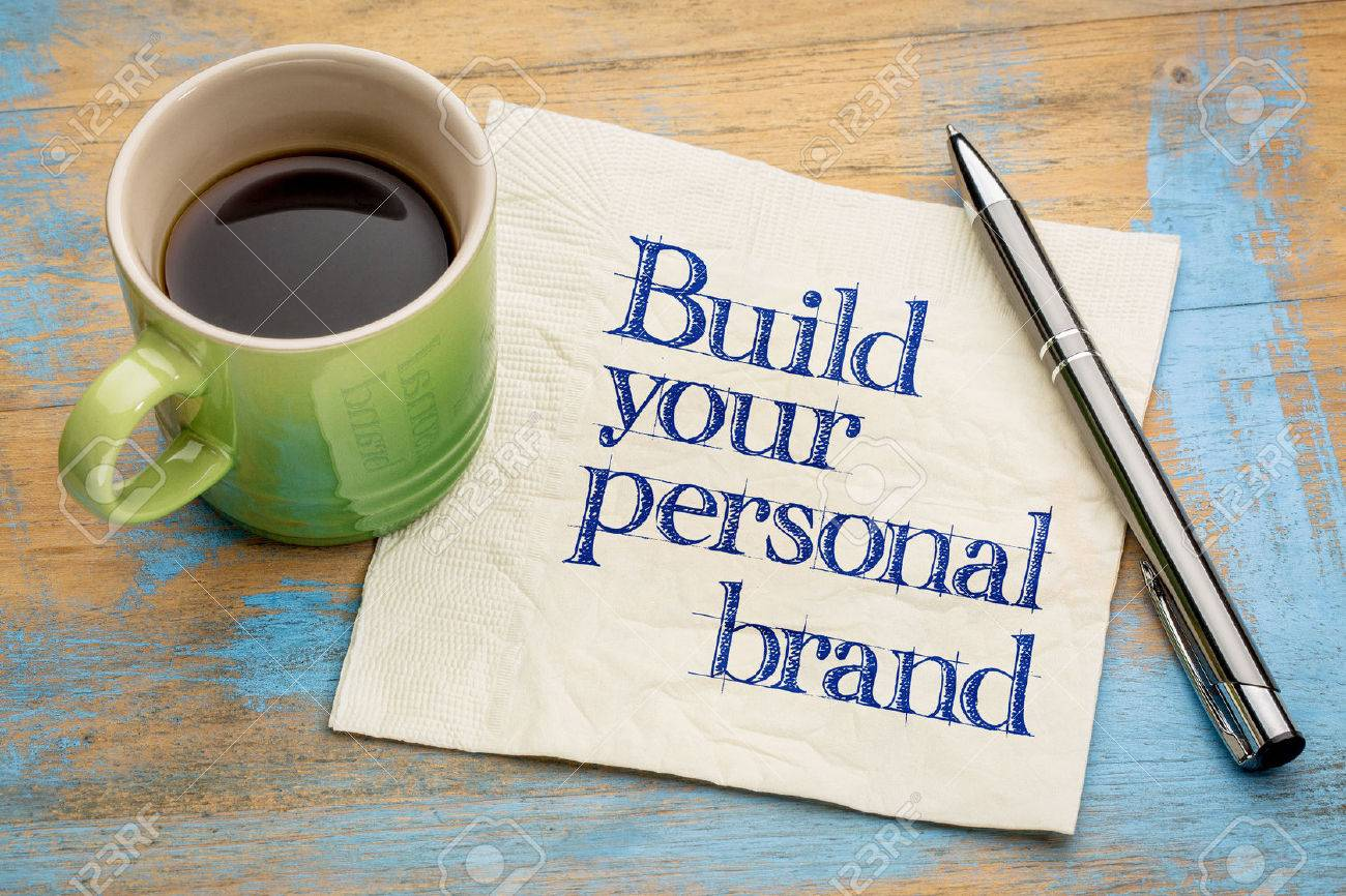 Build your personal brand advice - handwriting on a napkin with a cup of espresso coffee - 57103022