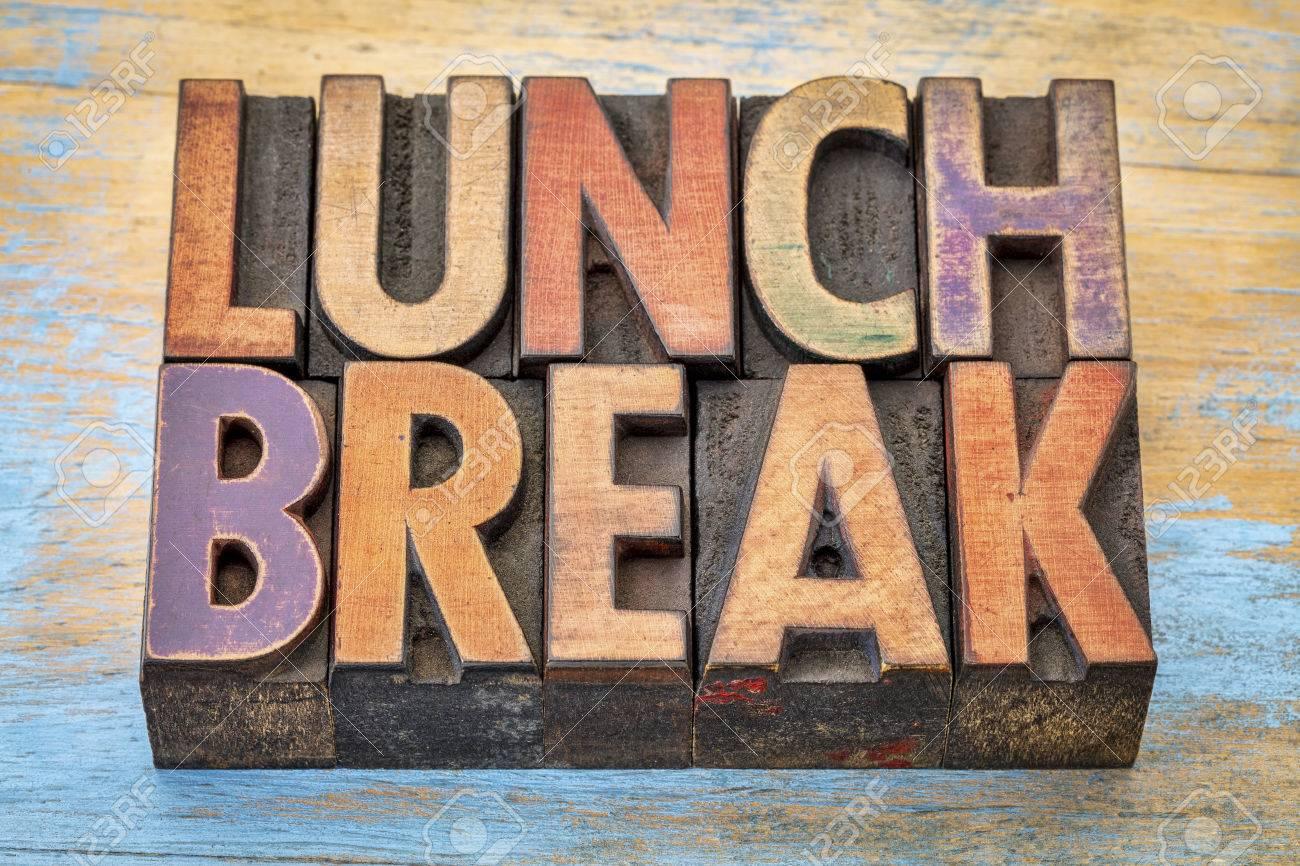 lunch break banner - text in vintage letterpress wood type printing blocks against grunge painted wood - 57129063