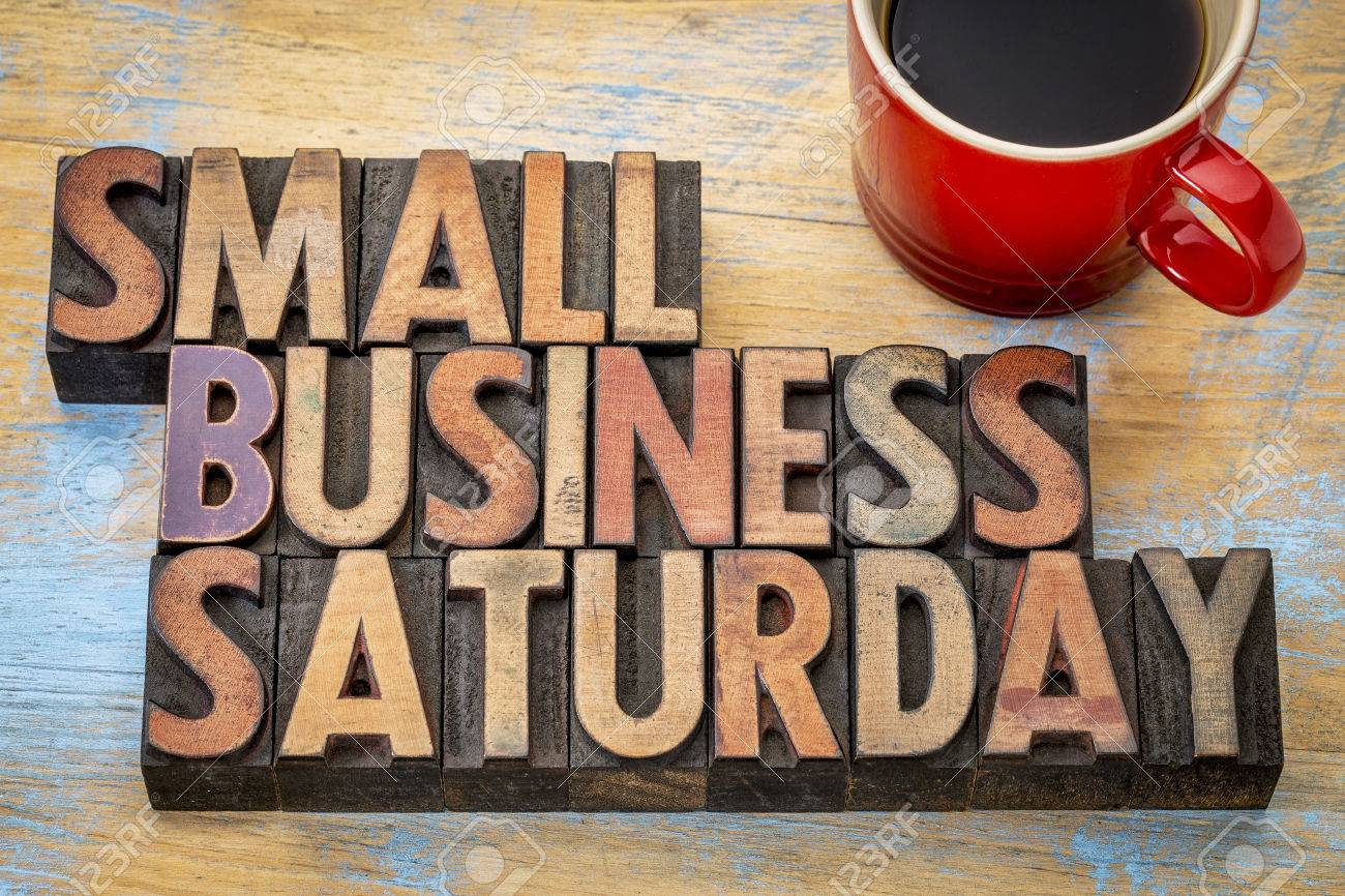 Small Business Saturday word abstract - text in vintage letterpress wood type with a cup of coffee, holiday shopping concept Stock Photo - 57341072