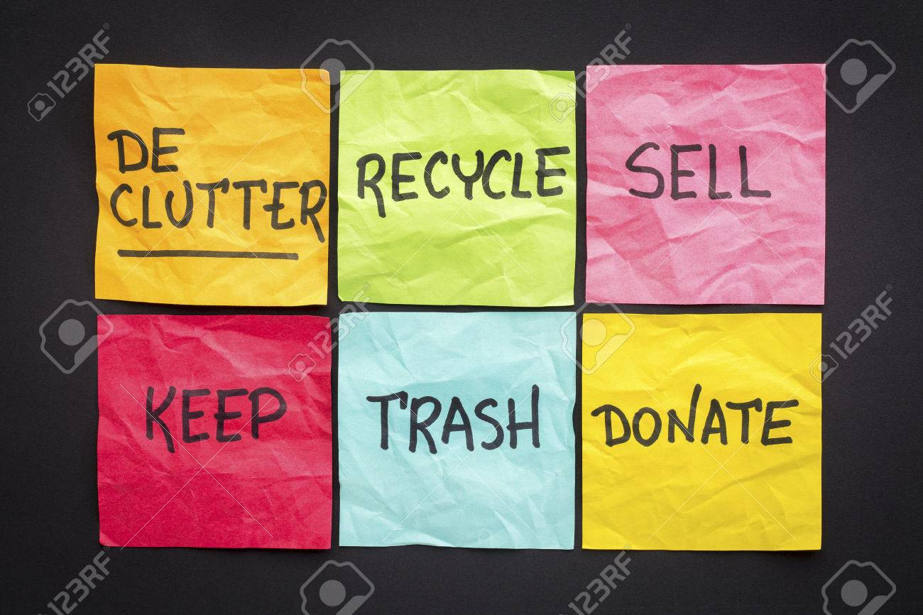 declutter concept (keep, recycle, trash, sell, donate - handwriting on color sticky notes against black paper background - 57708864