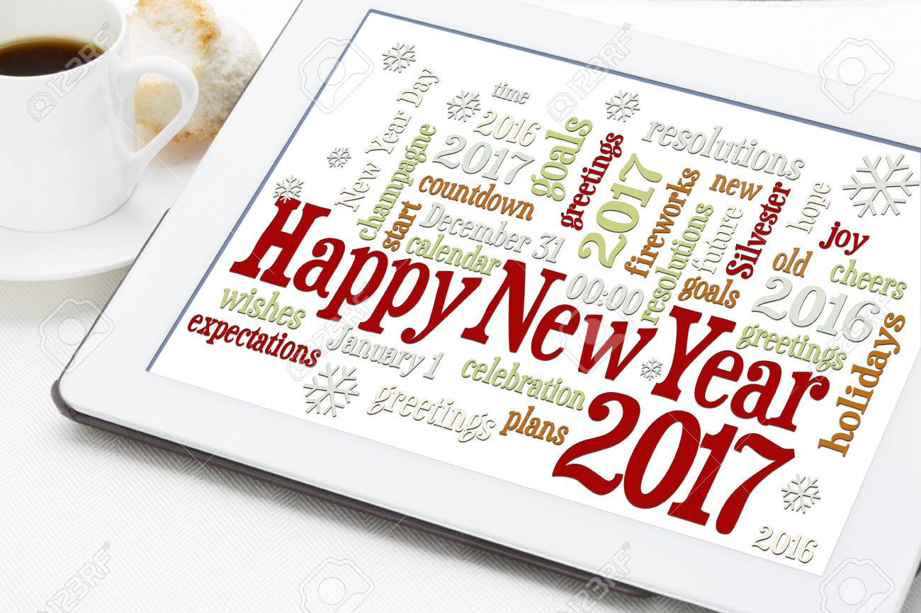 Happy New Year 2017 greetings - word cloud on a digital tablet with a cup of coffee Stock Photo - 59356299