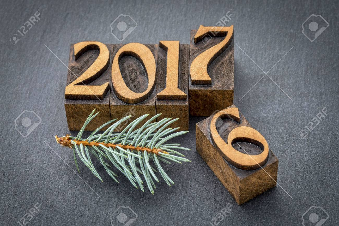 new year 2017 replacing the old year 2016 - letterpress wood type printing blocks on a slate stone Stock Photo - 63291937