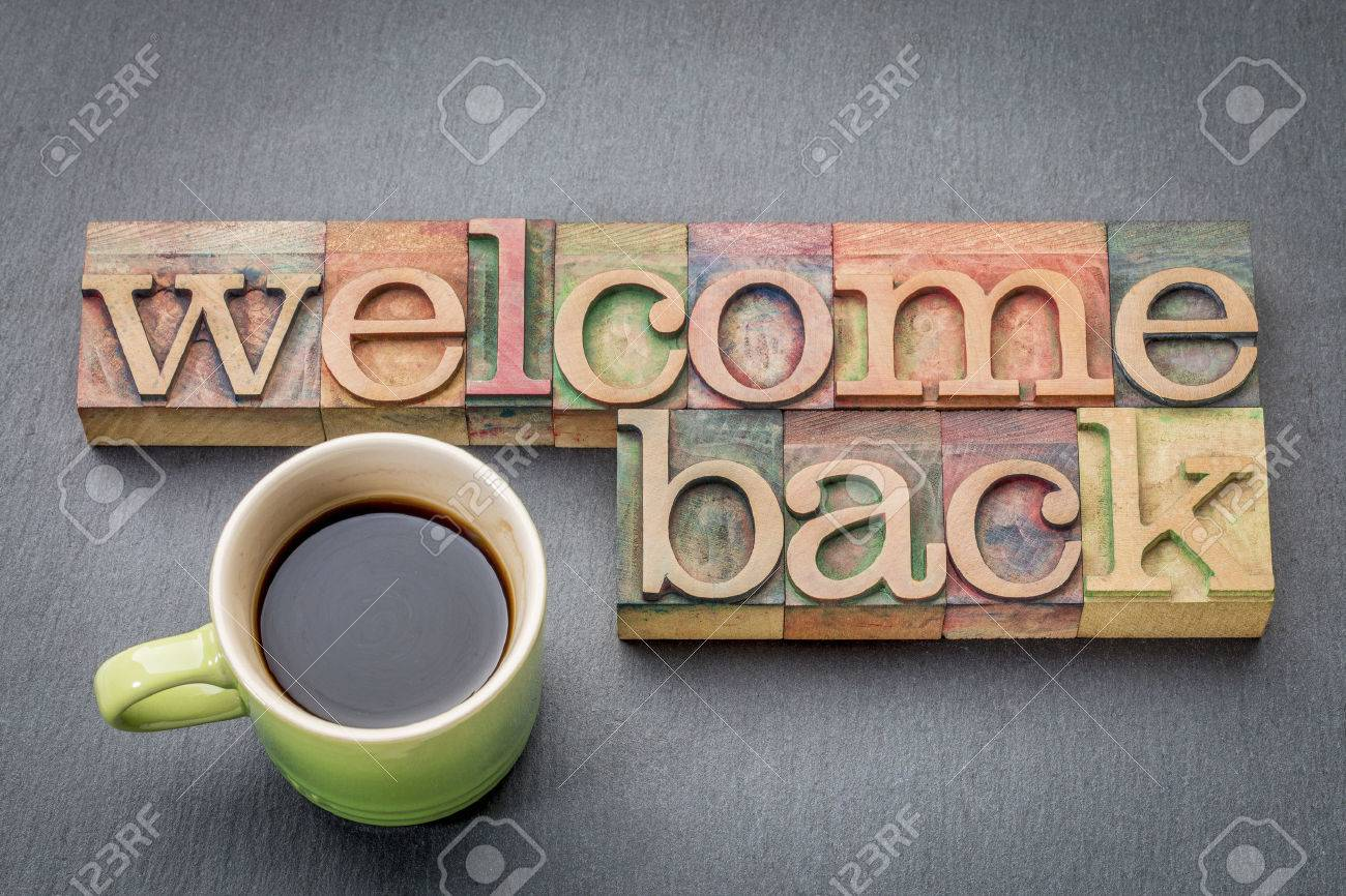 Welcome back sign - text in letterpress wood type with a cup of coffee - 67346092