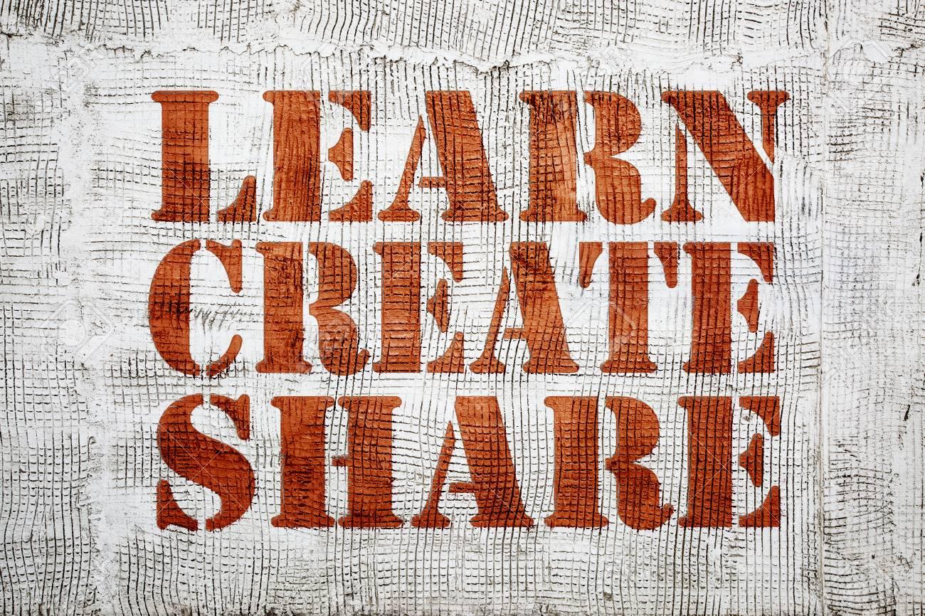 Learn Create Share Graffiti Sign With Arrow On Stucco Wall Stock Photo