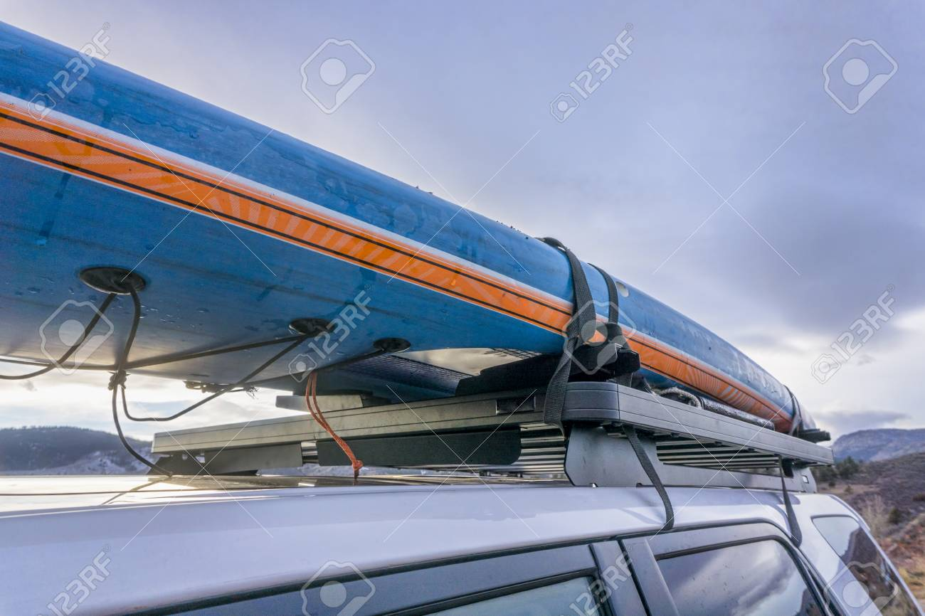 Paddle Board Car Racks >> Racing Stand Up Paddleboard On Roof Racks Of Suv Car