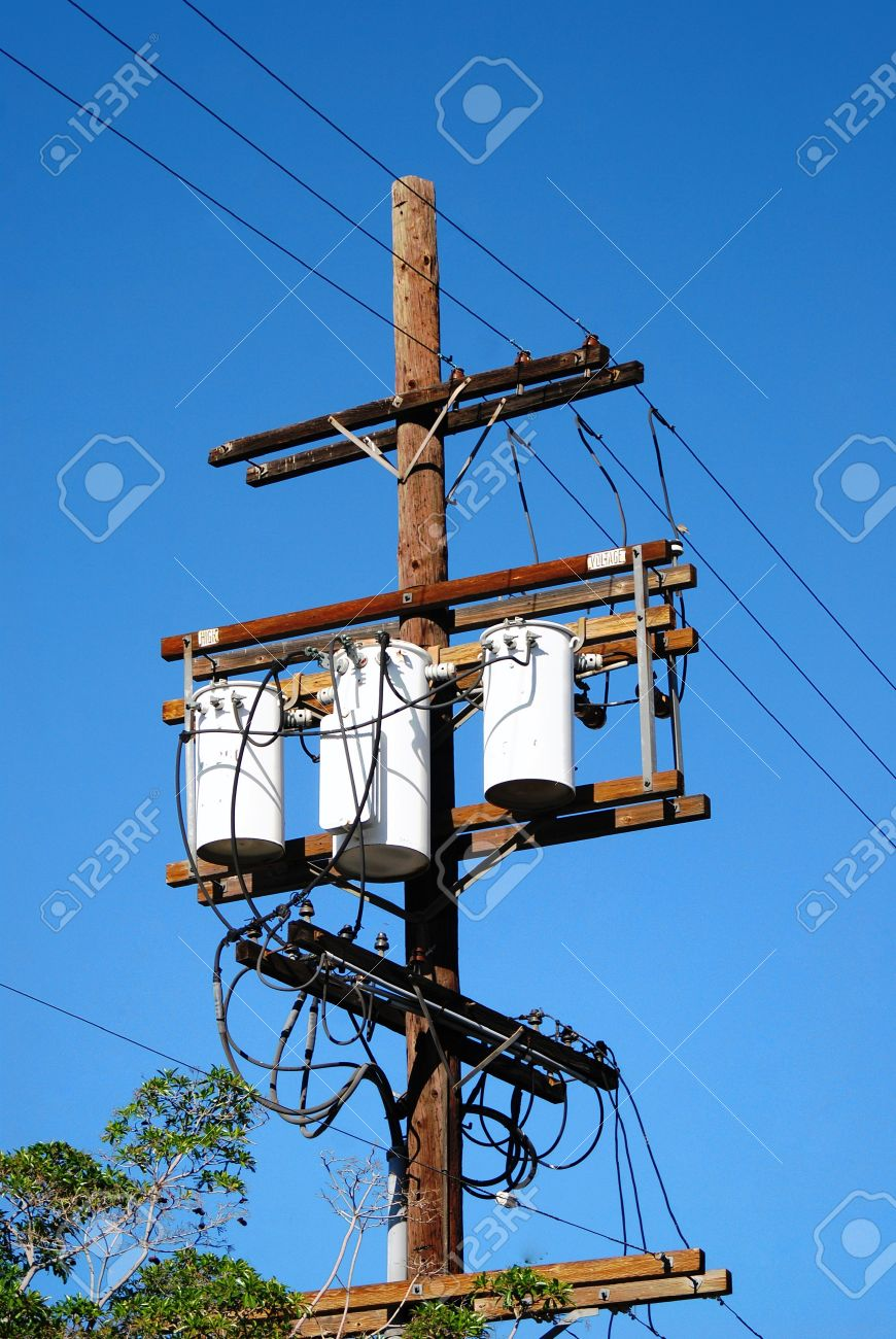 Three Transformers Connected To Three Lines Secured To A Telephone ...