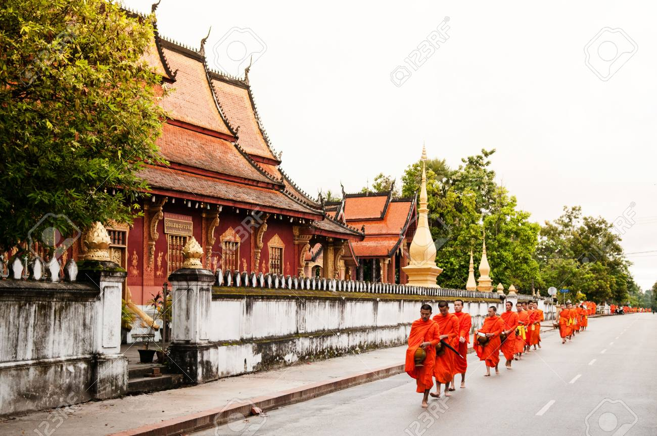 Sep 6, 2011 Luang Prabang, Laos : Traditional Alms giving ceremony of distributing food to buddhist monks on the streets - 87374361