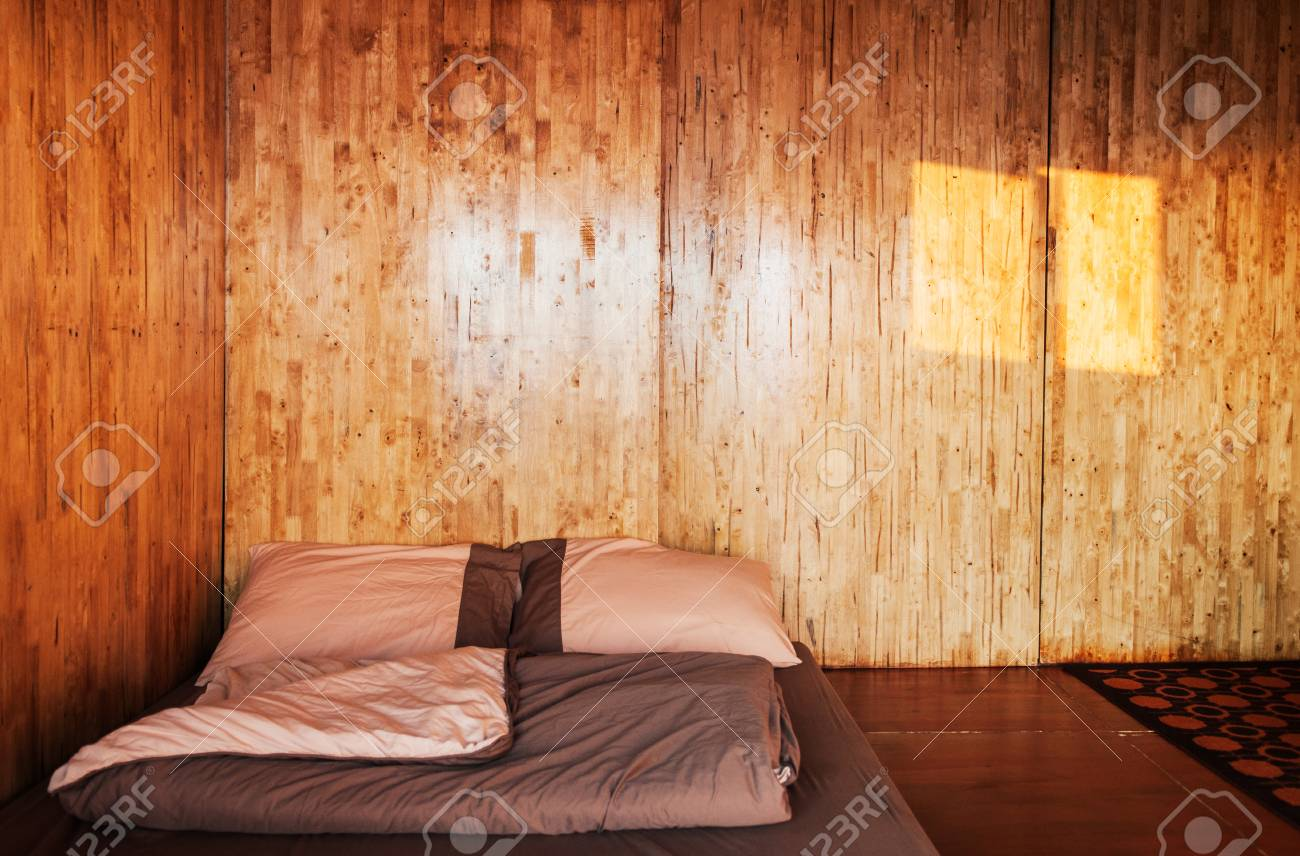 Warm Cozy Bedroom With Simple Futon On The Floor Log Cabin House