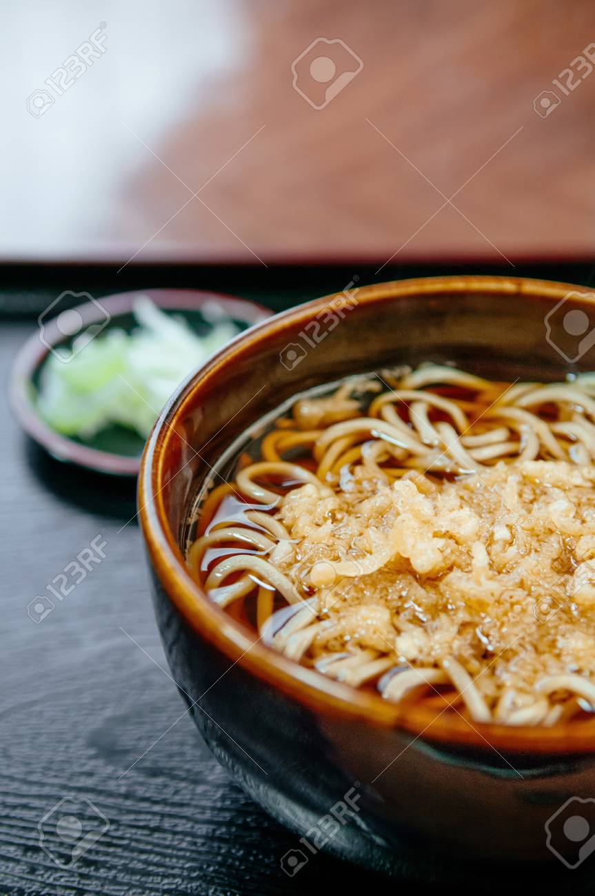 Japanese Hot Soba Noodle In Ceramic Bowl With Tempura Crumble