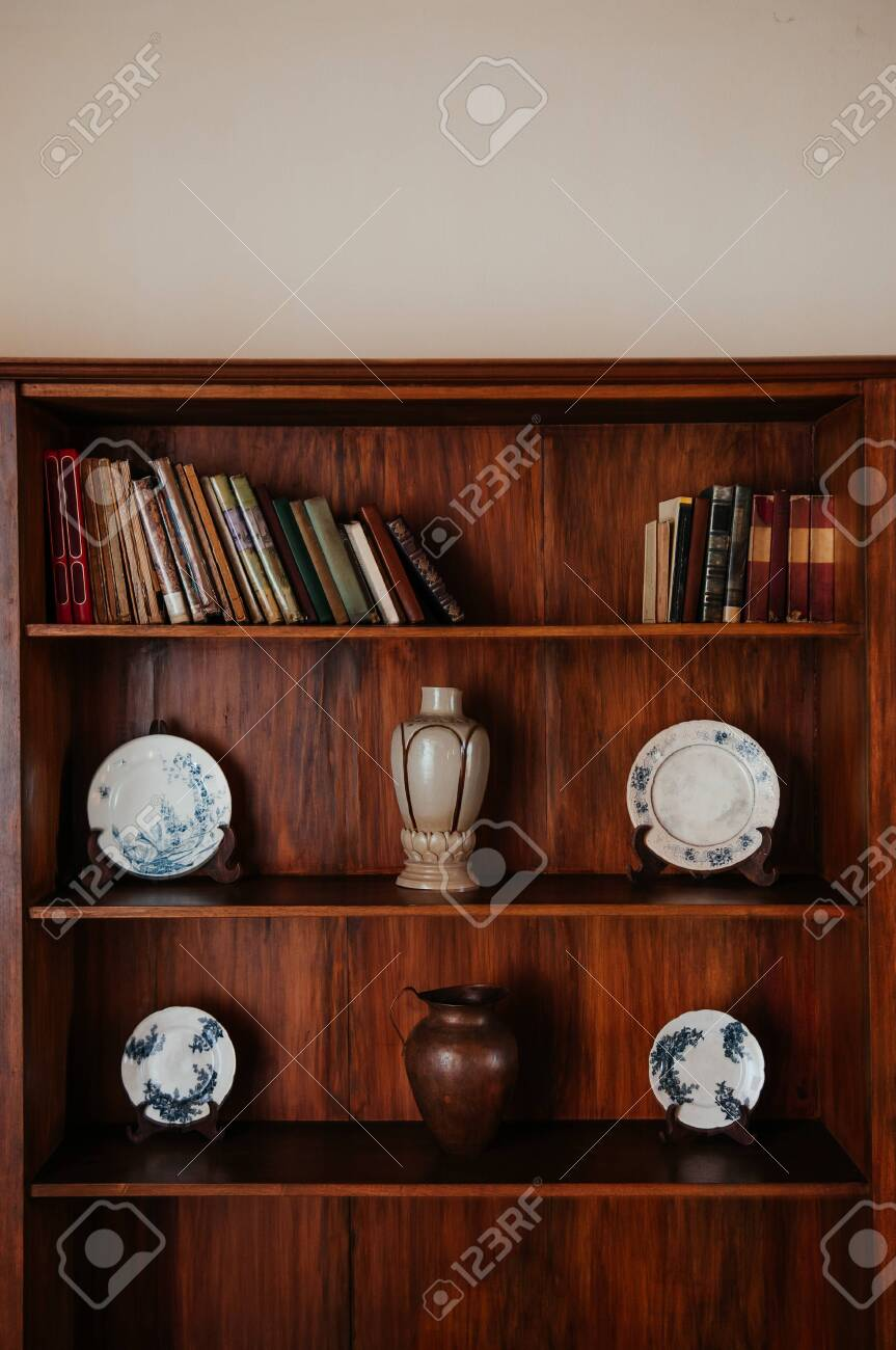 hot sale online f64d2 fca27 Wooden bookshelf with old books and blue pattern vintage Chinaware..