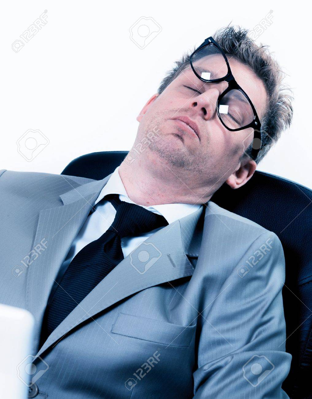 tired funny portrait of businessman sleeping at the office Stock Photo - 17795966