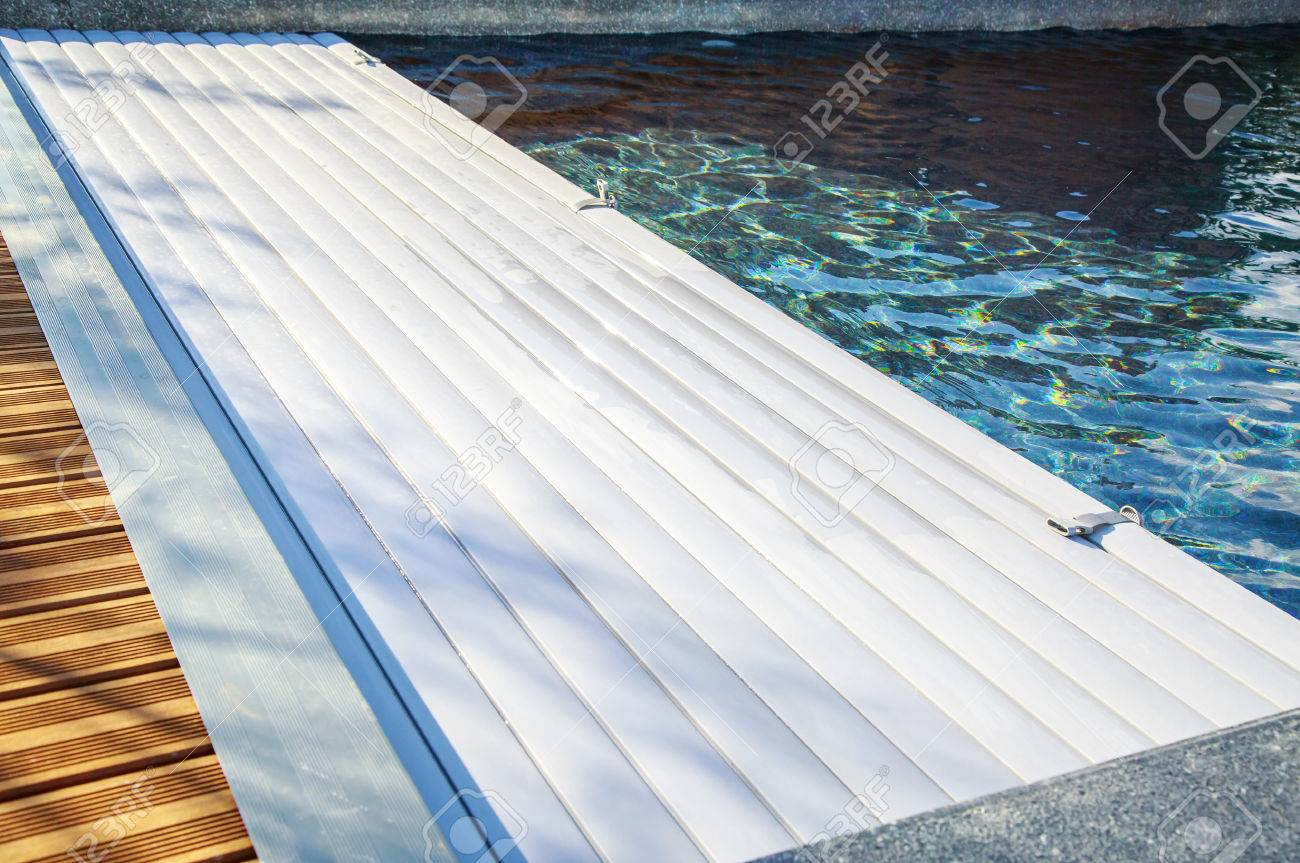 Captivating Closeup On Swimming Pool Roller Shutter Covers Stock Photo   66957140