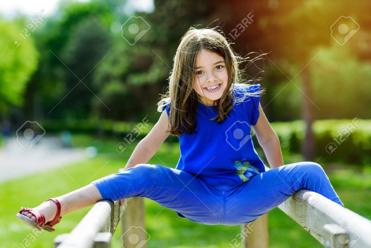 beautiful portrait of cute child playing with greenery in the background - 67738348