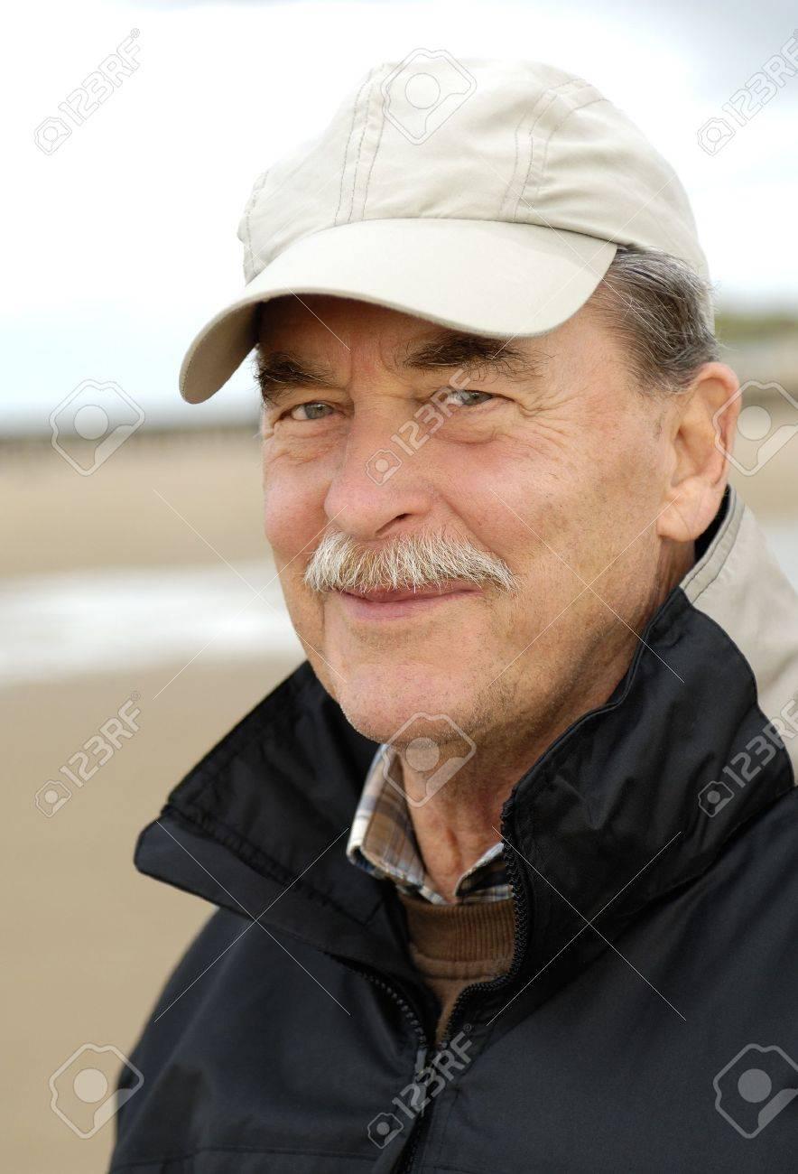 Happy smiling senior man with baseball cap Stock Photo - 7708697