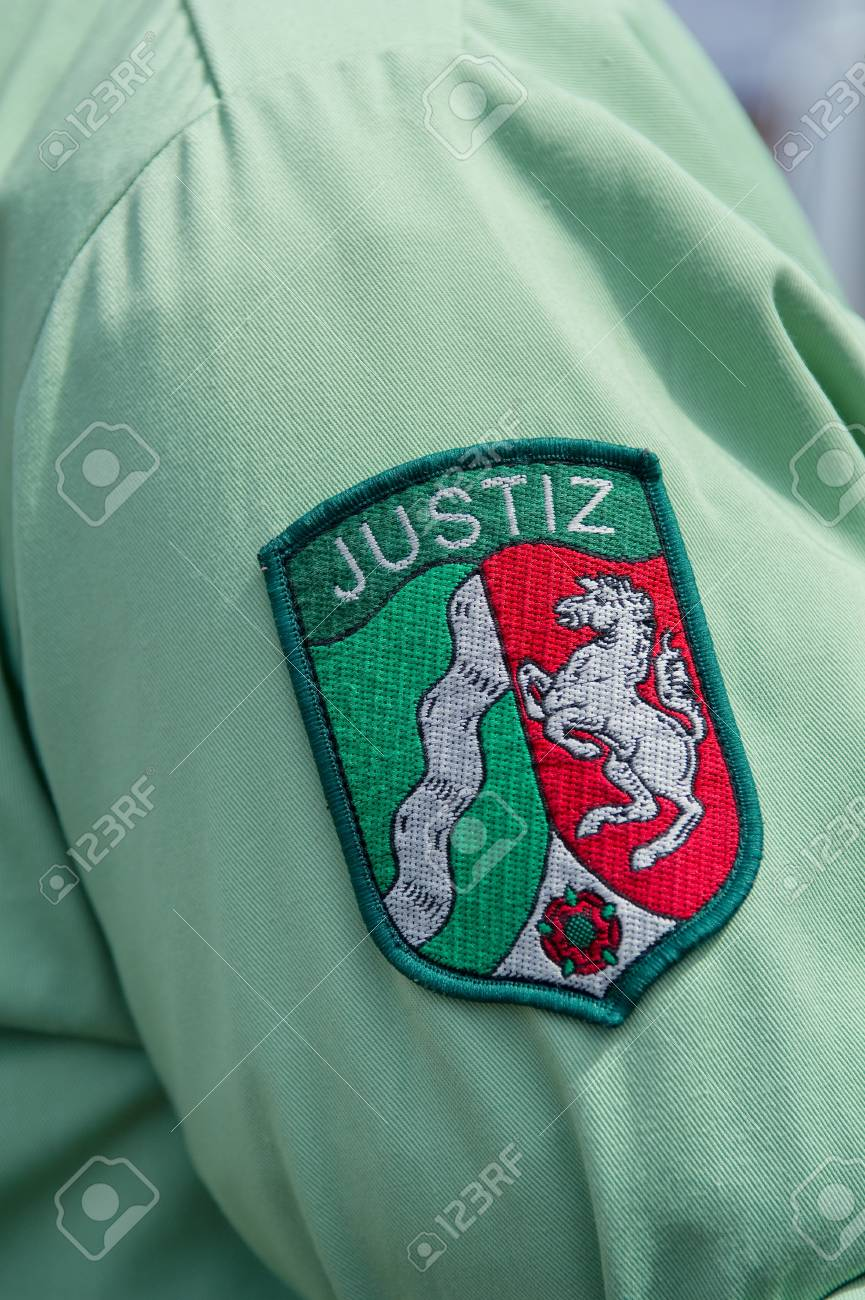 German Justice badge on a shirt sleeve Stock Photo - 12389799