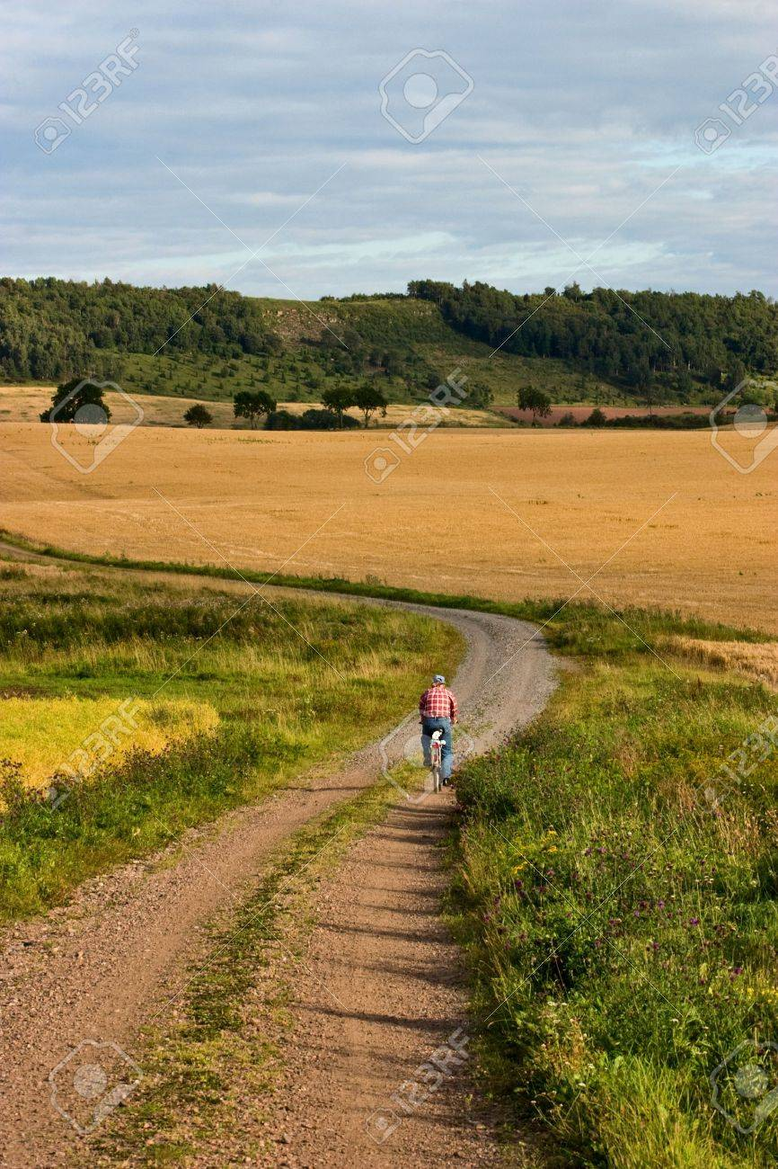cyclist on a gravel road Stock Photo - 10143054