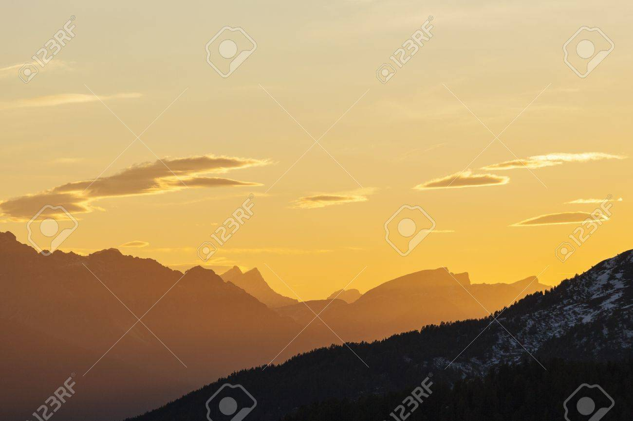 Mountains silhouette at sunset in the alps Stock Photo - 17022797