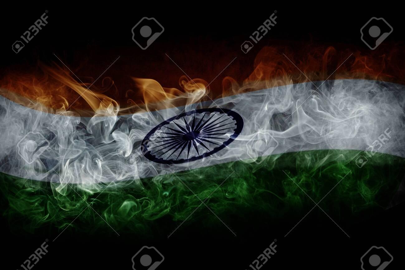 Indian flag with smoke isolated on dark black background - 153682296