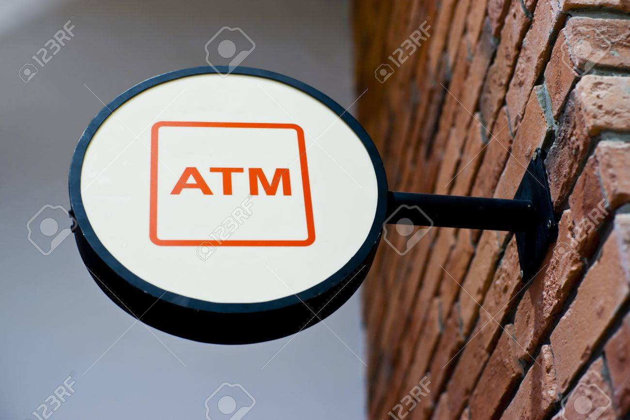 Circle shape ATM sign on brick wall Stock Photo - 11078743