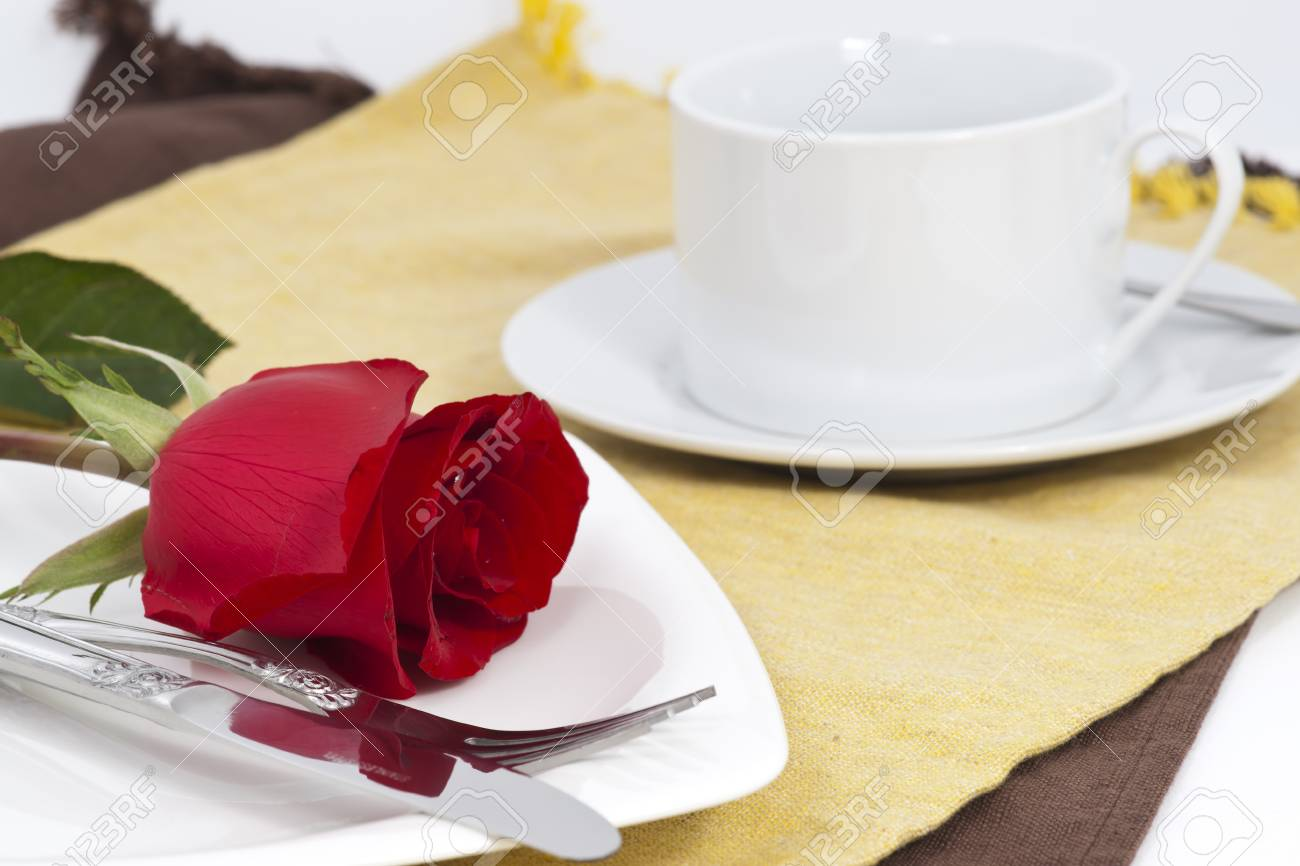 Valentine Series, Red rose and cutlery on white plate Stock Photo - 12123637