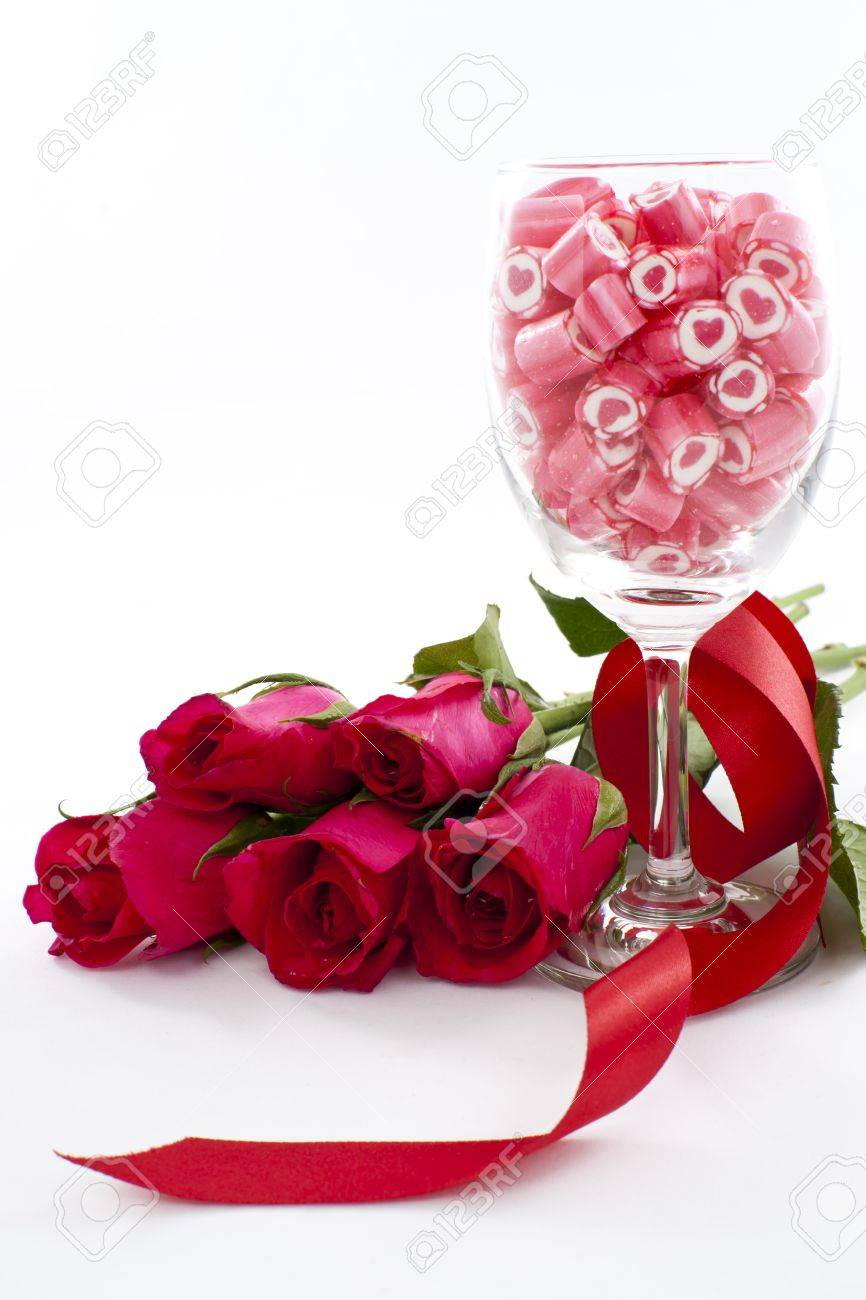 Valentine Series, Candy in wine glass with rose on white background Stock Photo - 12292821