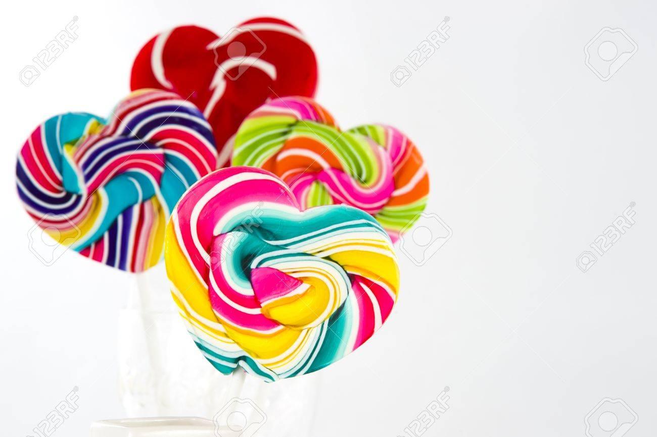Heart shape Swirl  lollipop on white background Stock Photo - 12742841
