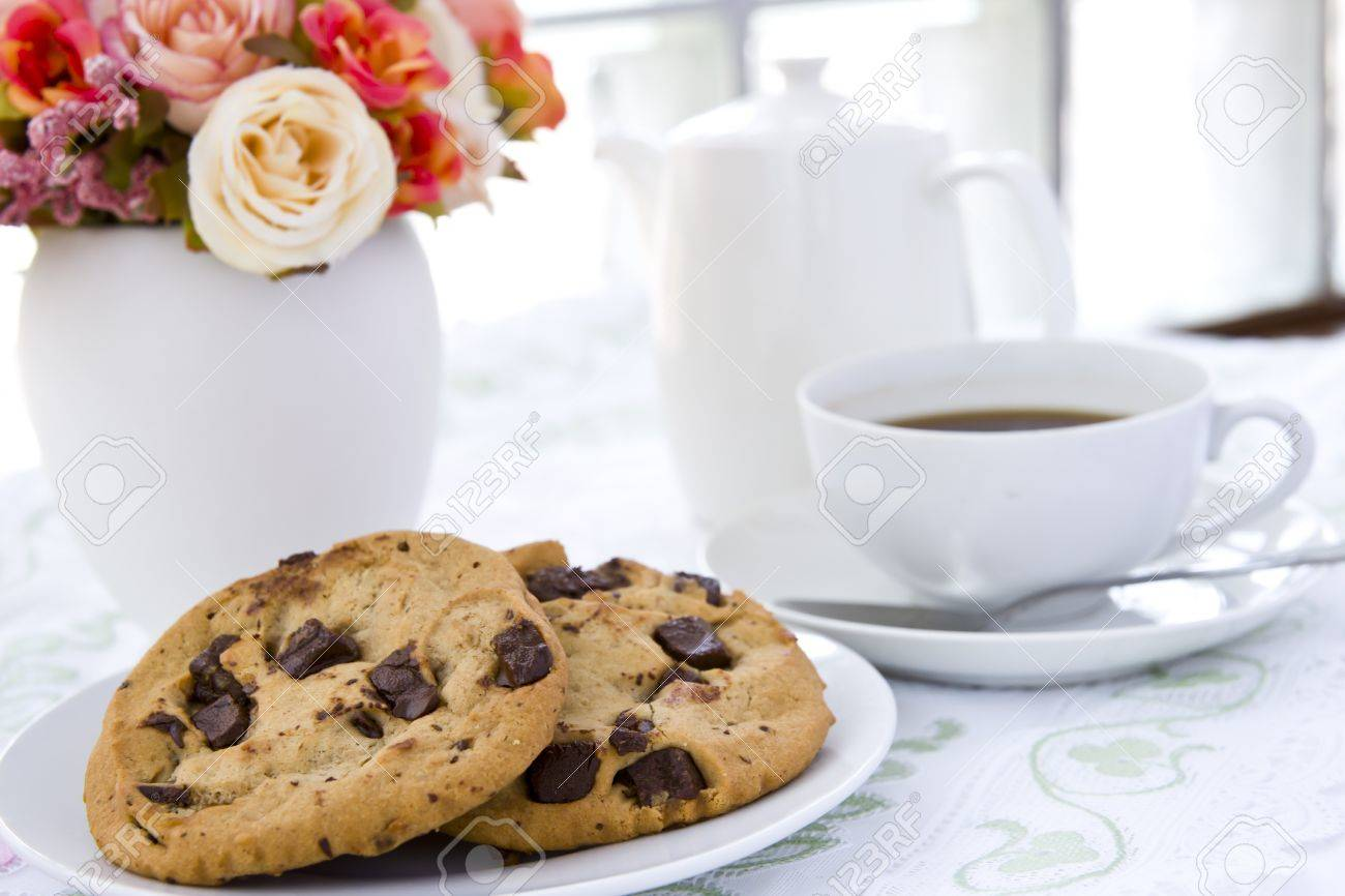 Chocolate chip cookie  on white plate with black coffee and flower Stock Photo - 13261007