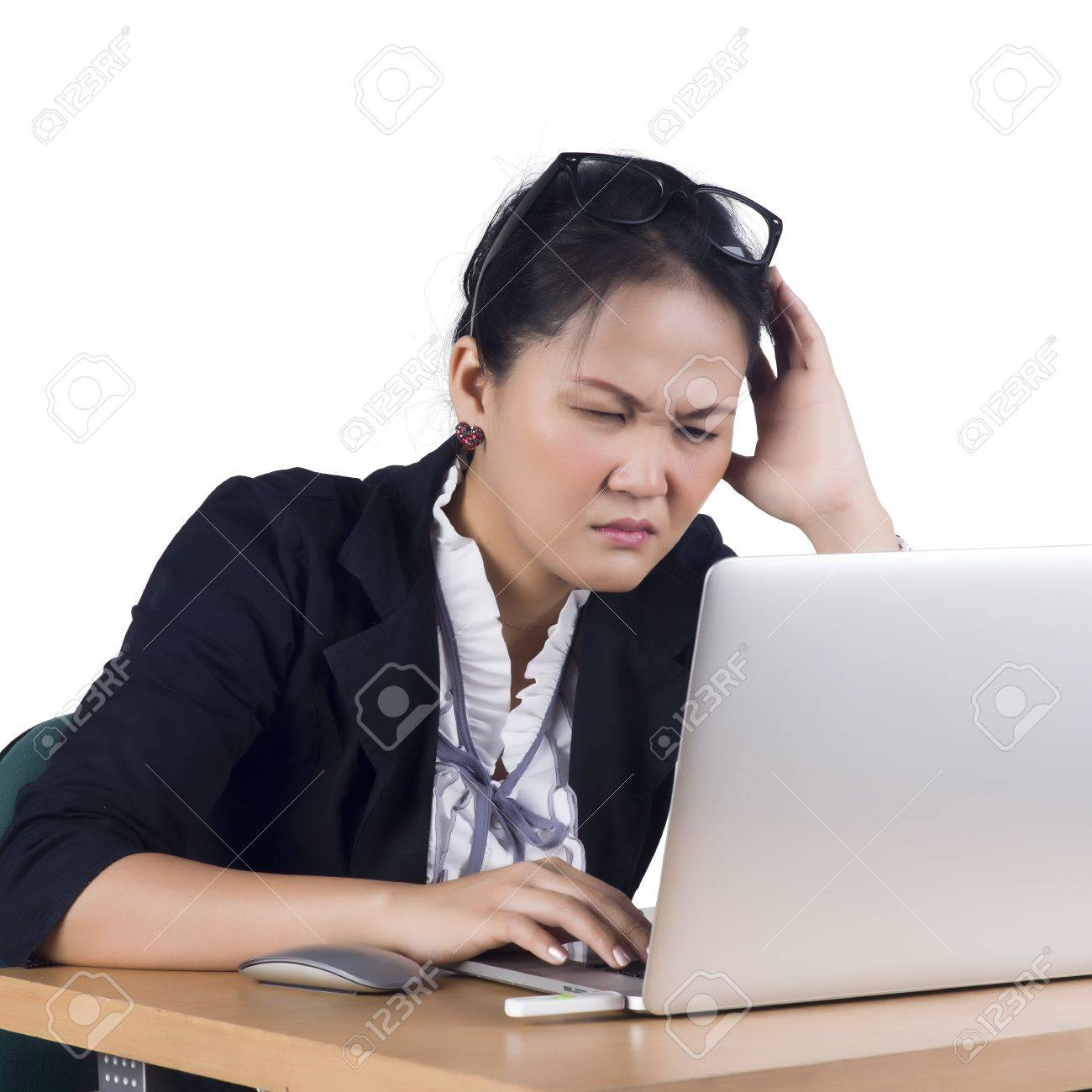 Bored business woman working on laptop looking very boring at the computer, Isolated white background. Model is Asian woman. Stock Photo - 17767298